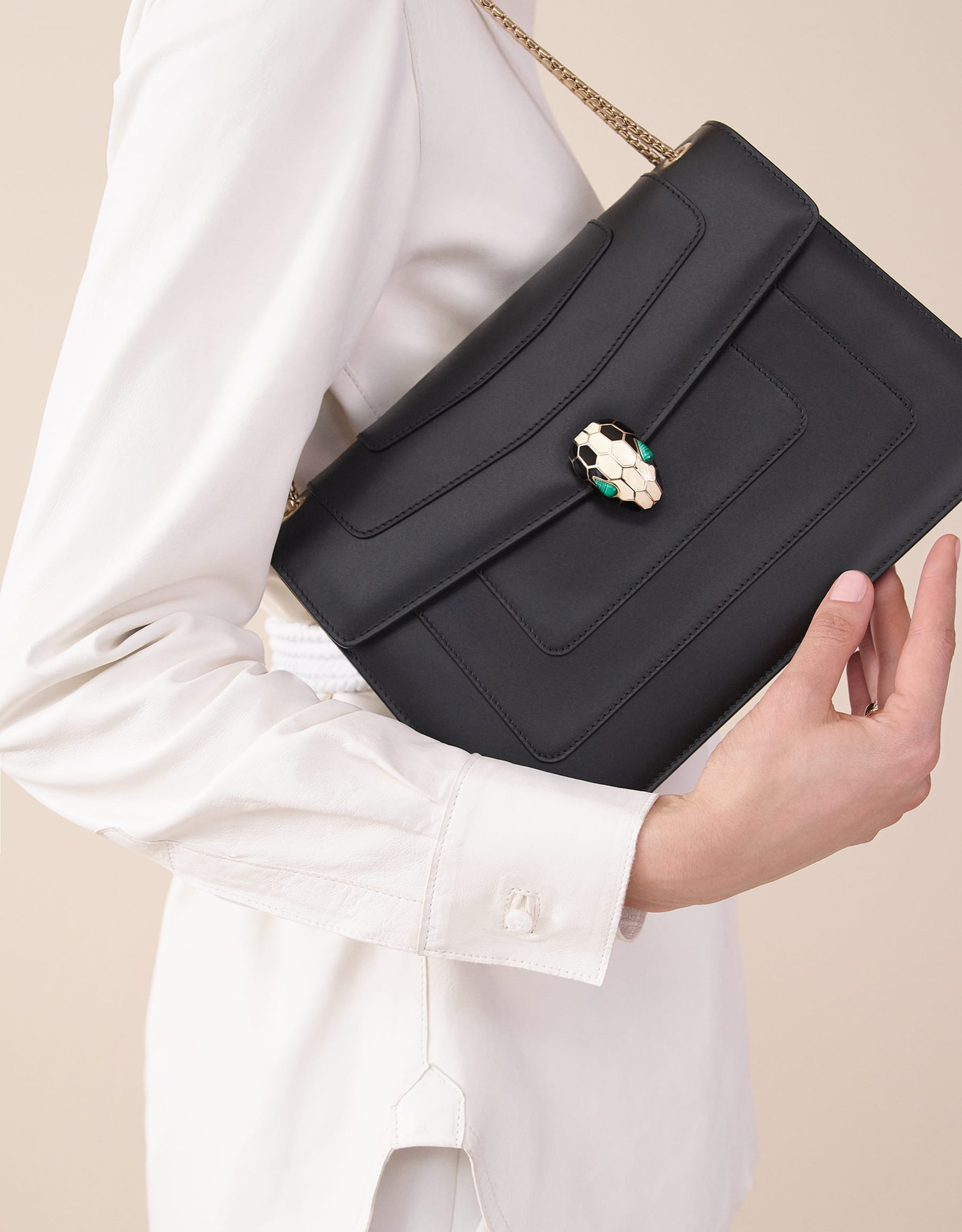Black calf leather shoulder bag with brass light gold plated black and white enamel Serpenti head closure with malachite eyes. 521-CLa image 5