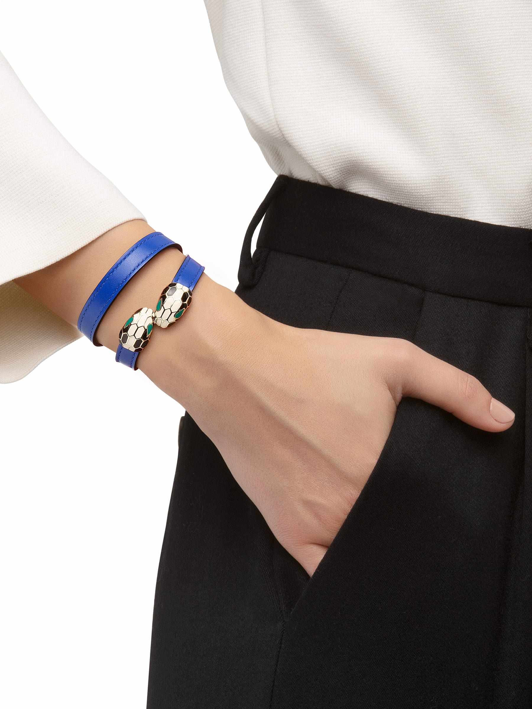 Serpenti Forever multi-coiled bracelet in cobalt tourmaline calf leather, with brass light gold plated hardware. Iconic contraire snakehead décor in black and white enamel, with green enamel eyes MCSerp-CL-CT image 2