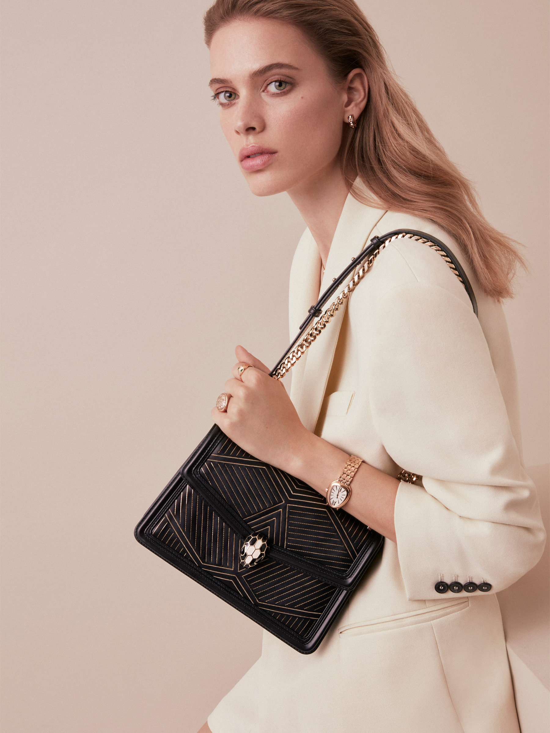 """Serpenti Diamond Blast"" shoulder bag in black smooth calf leather, featuring a Whispy Chain motif in light gold finishing. Iconic snake head closure in light gold plated brass enriched with black and white enamel and black onyx eyes. 288983 image 7"