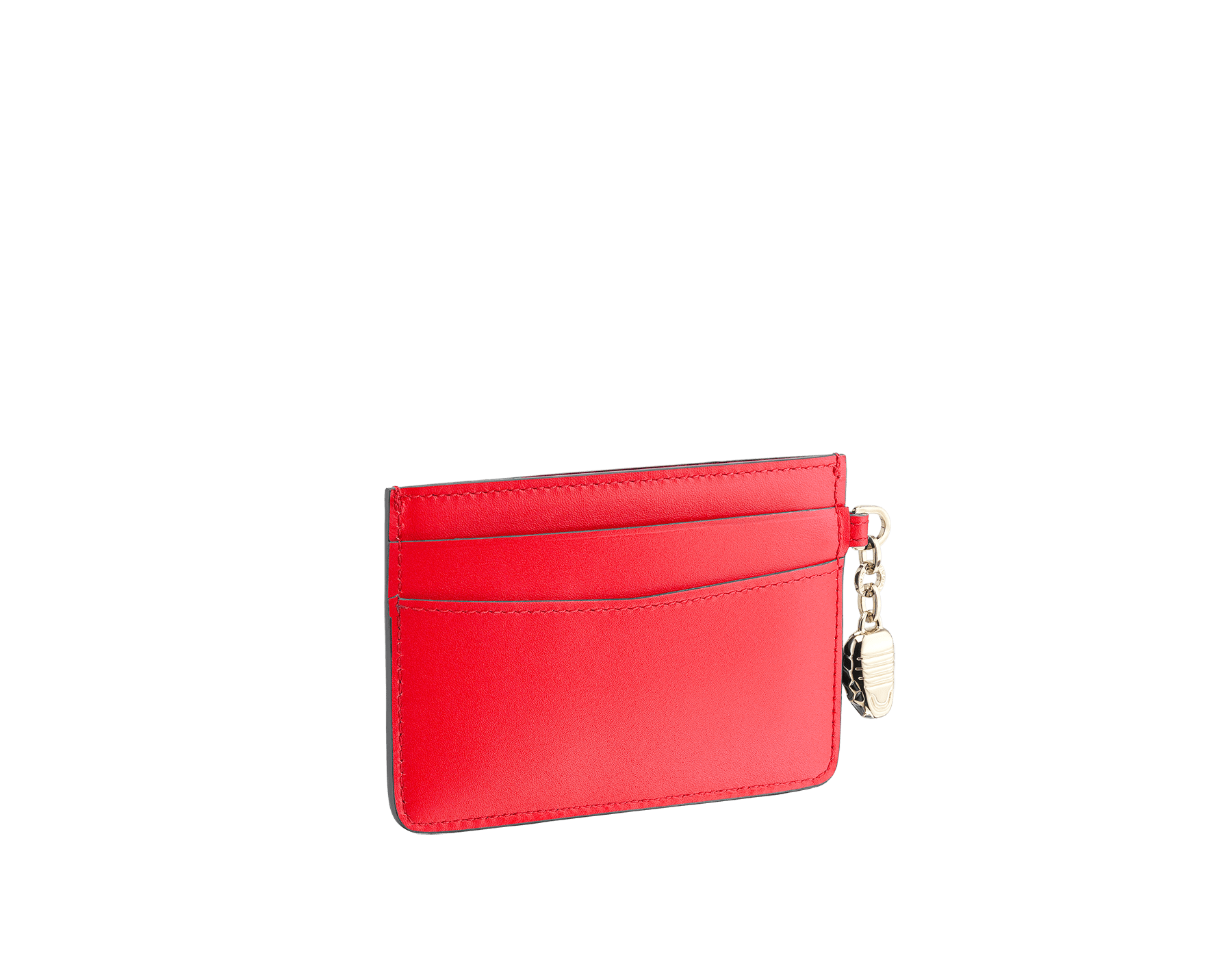 Serpenti Forever credit card holder in sea star coral and pink spinel calf leather. Iconic snakehead charm in black and white enamel, with green malachite enamel eyes. 288019 image 2
