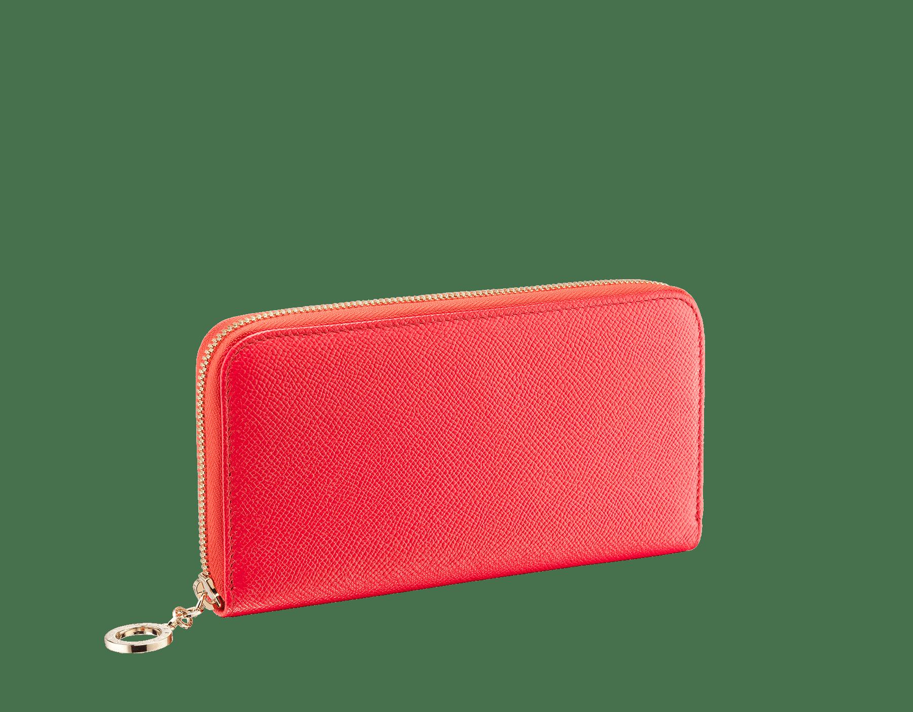 Carteira com zíper BVLGARIBVLGARI em couro de novilho granulado coral-estrela-do-mar brilhante e napa espinélio rosa. Detalhes em metal banhado a ouro claro e icônico puxador de zíper BVLGARIBVLGARI. 288182 image 1