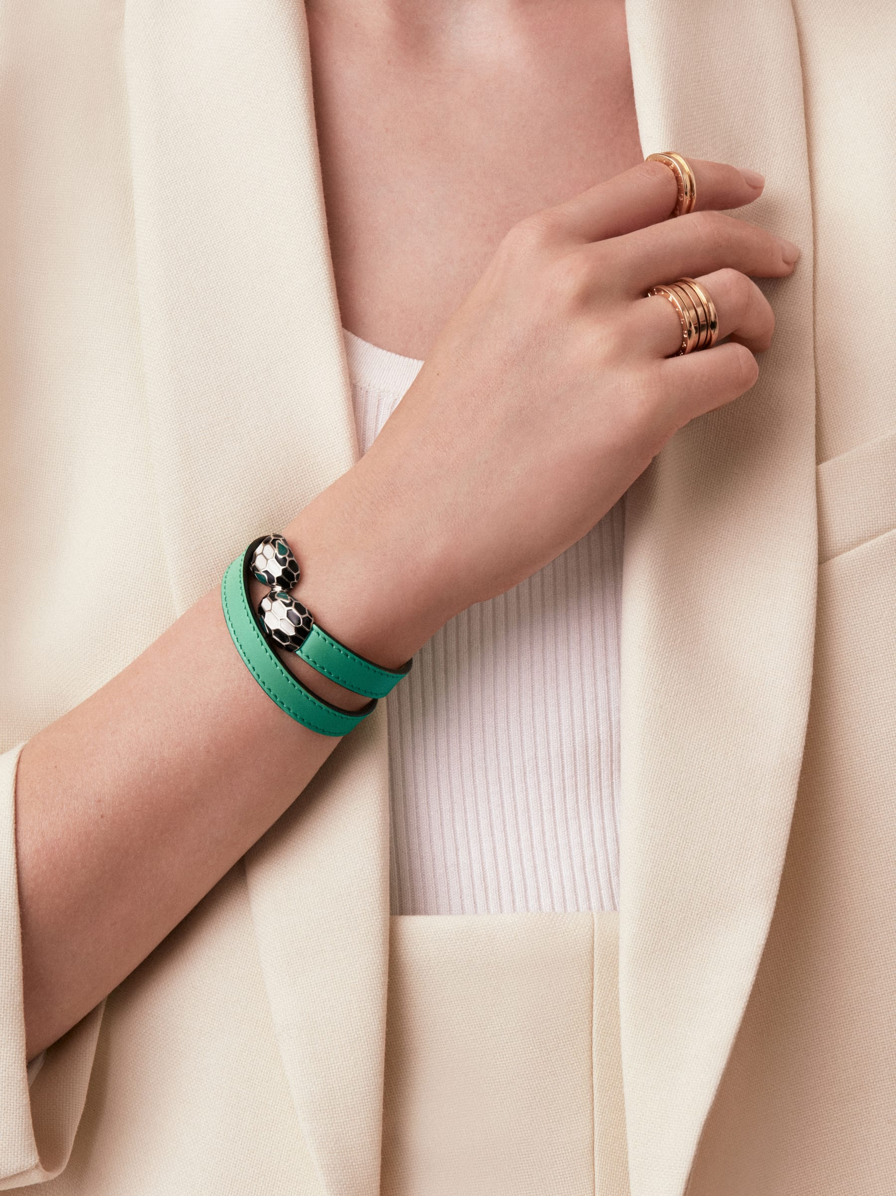 Multi-coiled bracelet in emerald green calf leather. Brass light gold plated iconic contraire Serpenti head closure in black and white enamel with malachite enamel eyes. Also available in other colours. MCSerp-CL-EG image 5