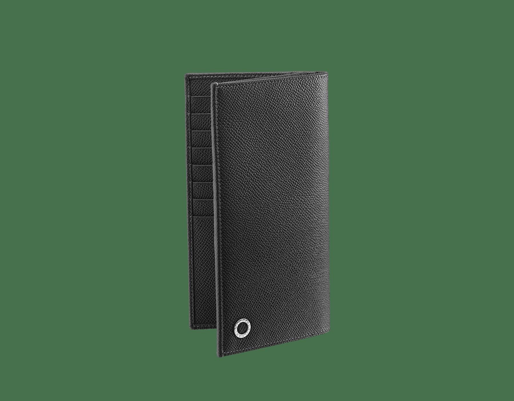 Carteira para yen em couro de novilho granulado preto com detalhes em latão banhado a paládio e o icônico motivo BVLGARI∙BVLGARI. 285737 image 1