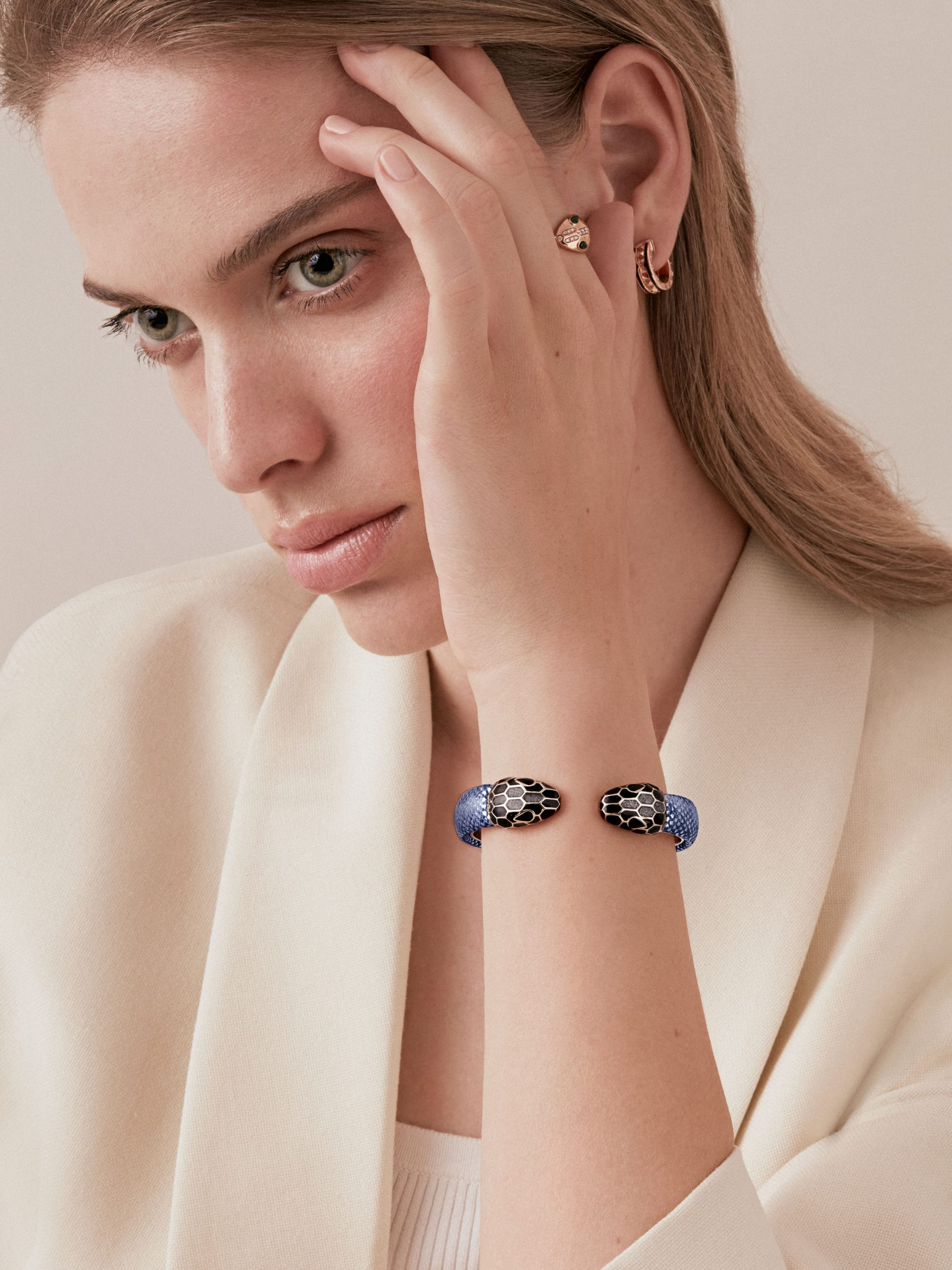 """""""Serpenti Forever"""" bangle in metallic Midnight Sapphire blue karung skin with light gold-plated brass details. Iconic face-to-face snakeheads with black and glittery Hawk's Eye grey enamel and seductive black enamel eyes. SPContr-MK-MidSapph image 2"""