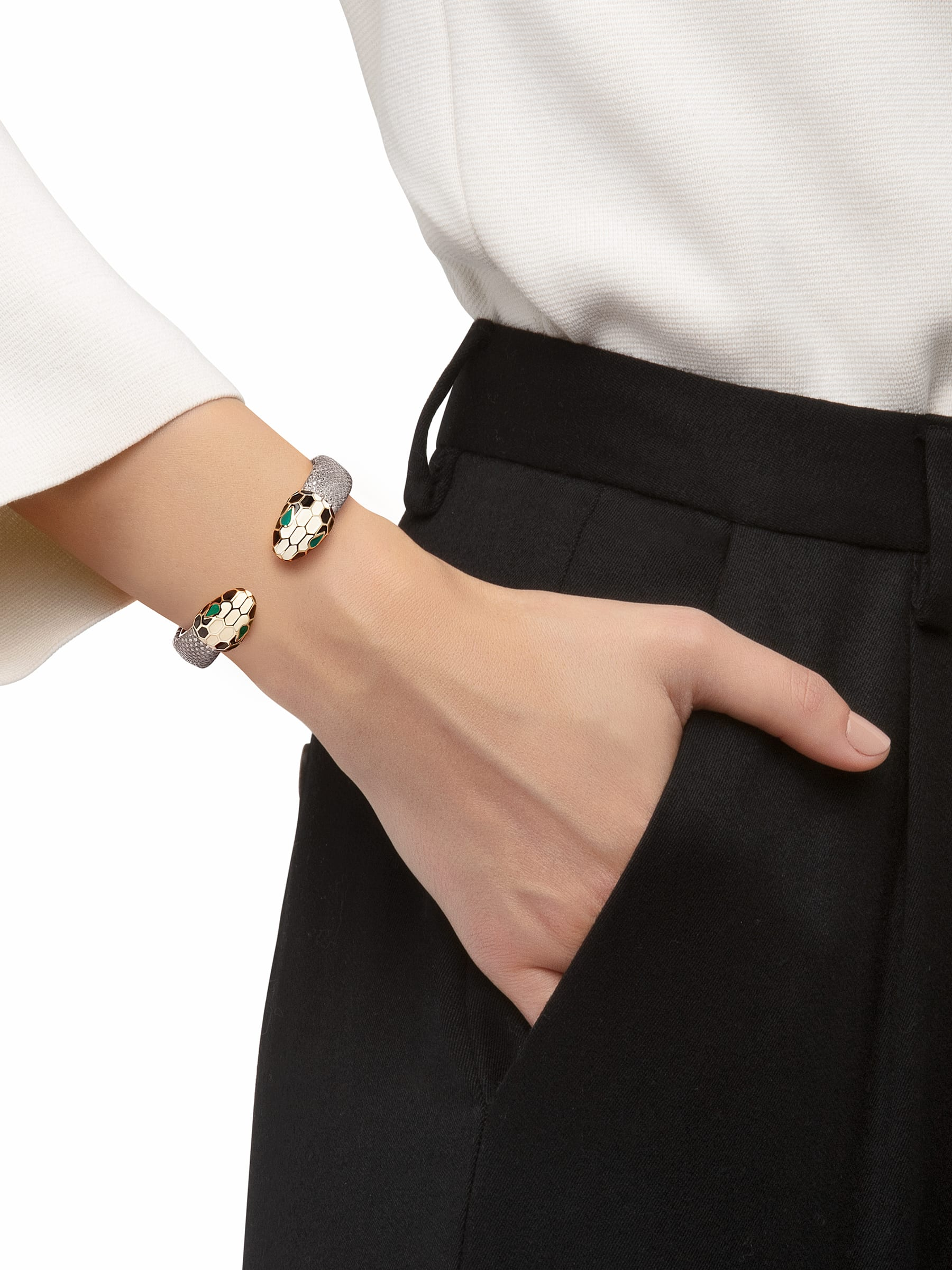 Bracelet in silver metallic karung skin with iconic contraire brass light gold plated Serpenti heads motif in black and white enamel, with green enamel eyes. SPContr-MK-S image 2