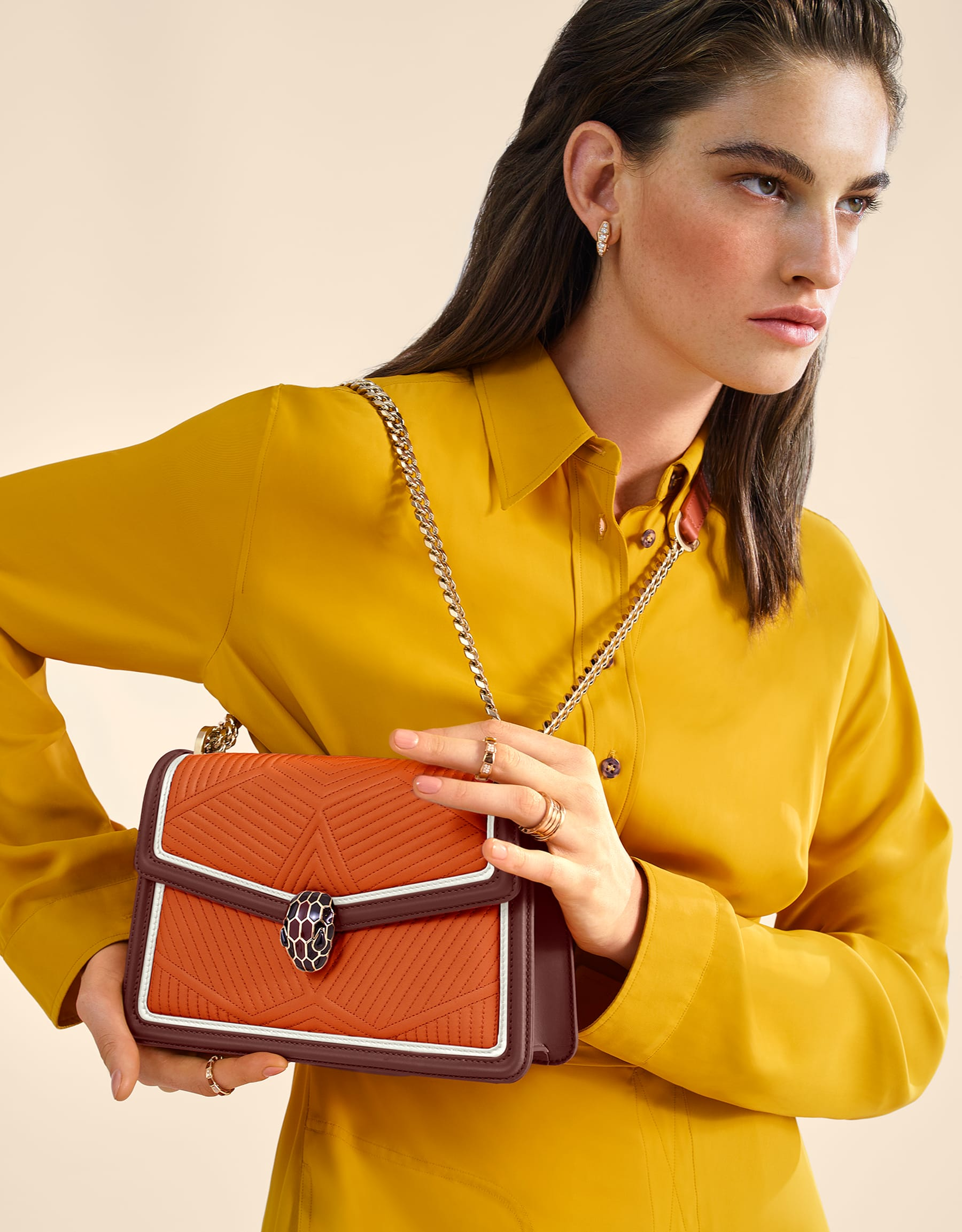 Serpenti Diamond Blast shoulder bag in imperial topaz quilted nappa leather with white agate and Roman garnet calf leather frames. Iconic snakehead closure in light gold plated brass embellished with Roman garnet and black enamel and black onyx eyes. 288827 image 5