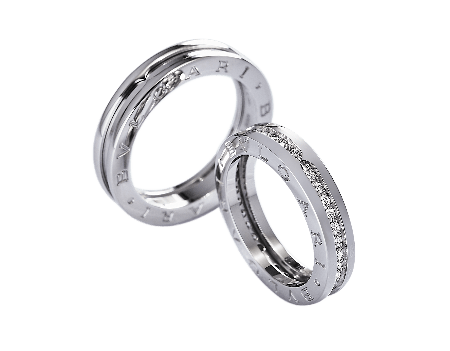 B.zero1 one-band couples' rings in 18 kt white gold, one of which set with pavé diamonds on the spiral. A timeless ring set fusing visionary design with bold charisma. Bzero1-One-Band-Couples-Rings image 1