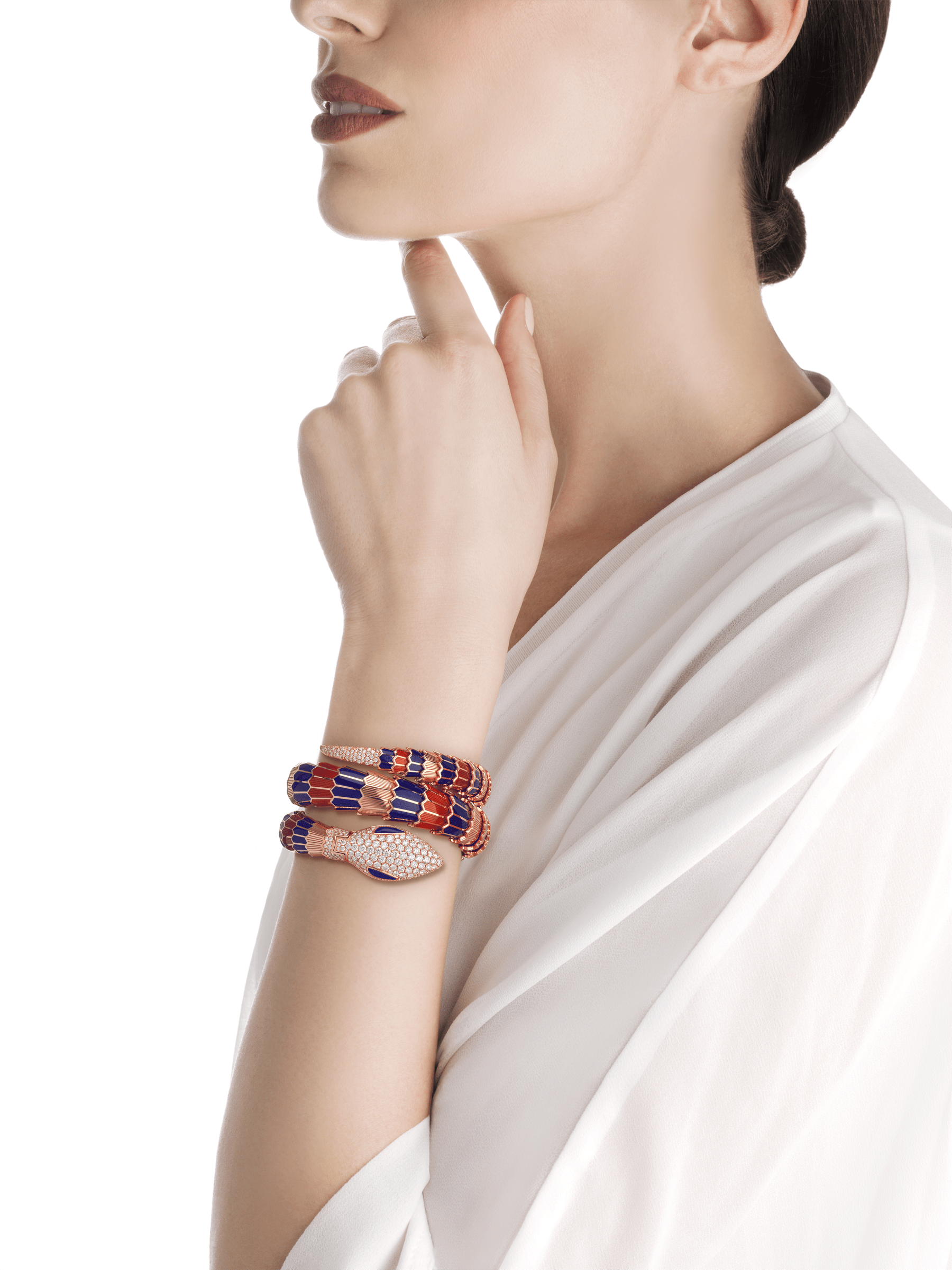 Serpenti Secret Watch with 18 kt rose gold head set with pavé diamonds and lapis lazuli eyes, 18 kt rose gold case, 18 kt rose gold dial set with brilliant cut diamonds, 18 kt rose gold double spiral bracelet coated with blue and red lacquer and set with pavé diamonds. 102445 image 3