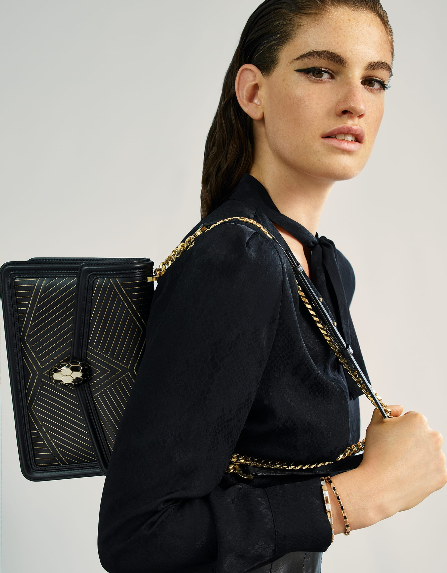 """Serpenti Diamond Blast"" shoulder bag in black smooth calf leather, featuring a Whispy Chain motif in light gold finishing. Iconic snake head closure in light gold plated brass enriched with black and white enamel and black onyx eyes. 288983 image 6"