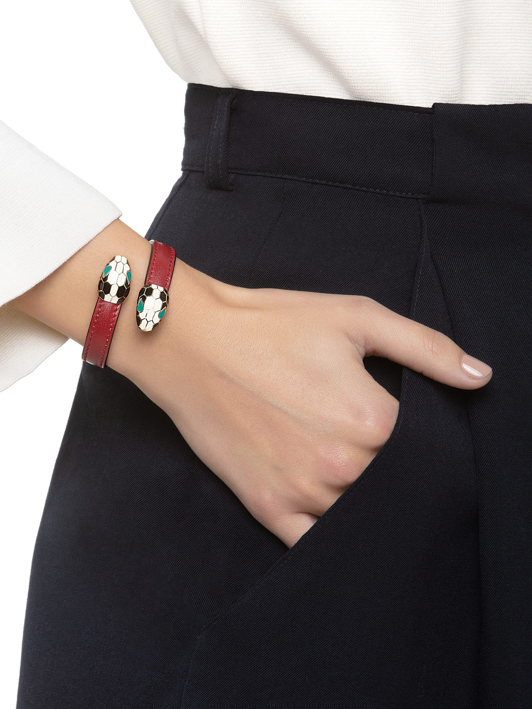 Serpenti Forever soft bangle bracelet in ruby red calf leather, with brass light gold plated hardware. Iconic contraire snakehead décor in black and white enamel, with green enamel eyes SerpSoftContr-CL-RR image 2