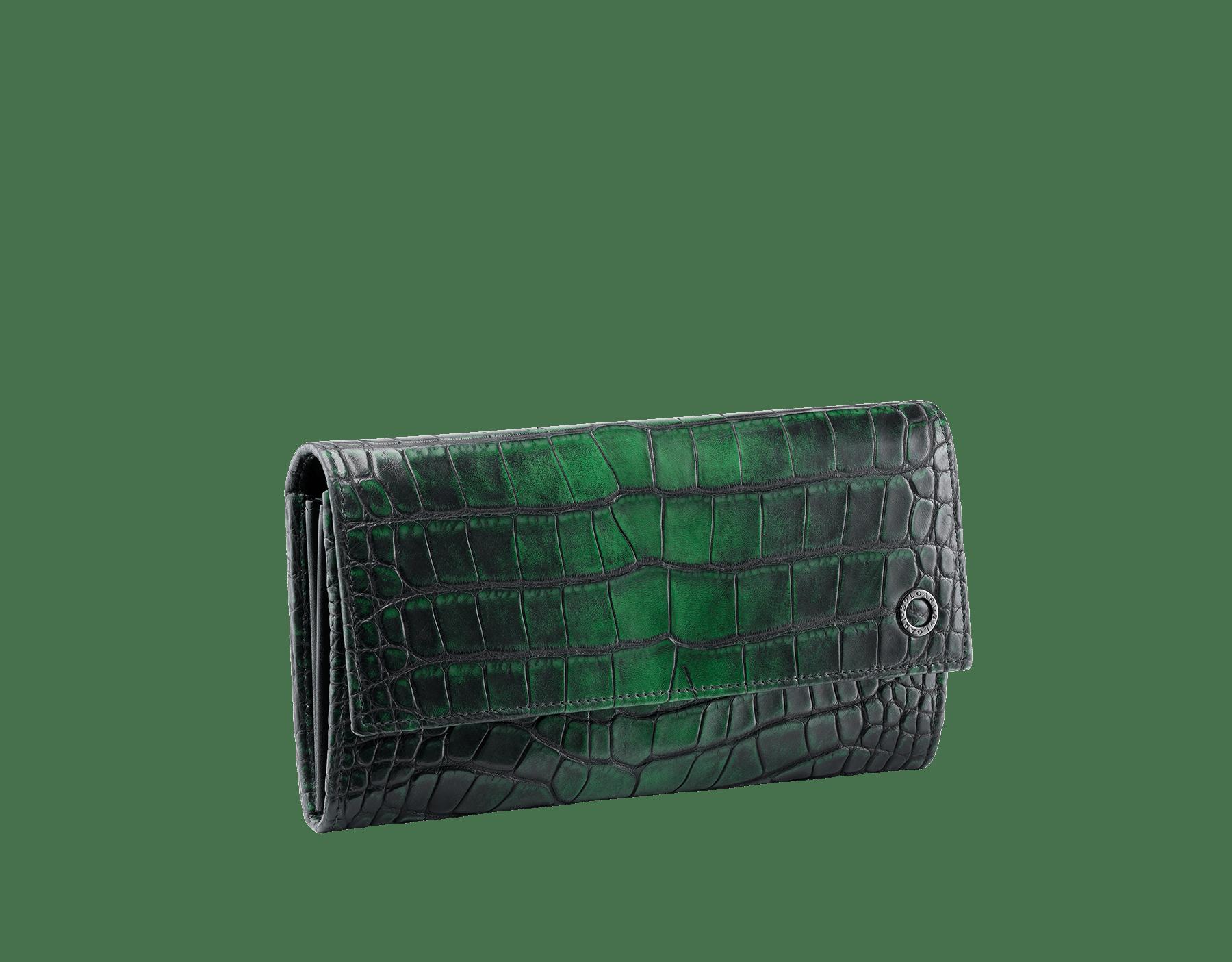 Man wallet pochette in Jungle green alligator skin and black smooth calf leather, with brass dark ruthenium plated hardware featuring the Bulgari-Bulgari motif. BBM-WLT-POC-10C-HE image 1