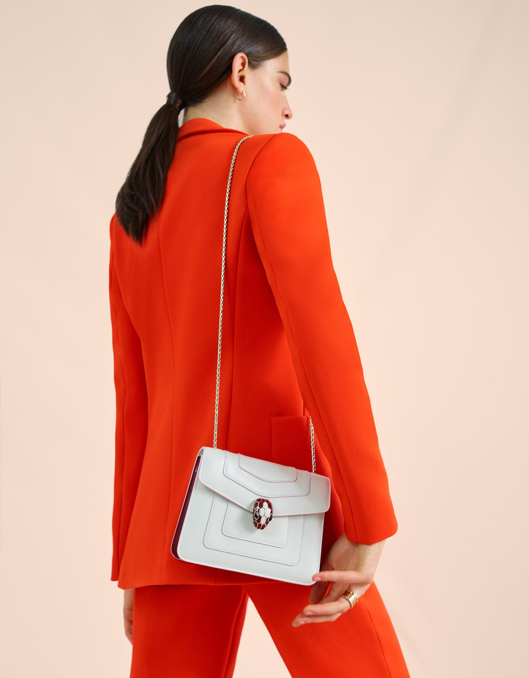 """Serpenti Forever"" crossbody bag in white agate calf leather body and ruby red calf leather sides. Iconic snakehead closure in light gold plated brass enriched with ruby red and white agate enamel and black onyx eyes. 289198 image 5"