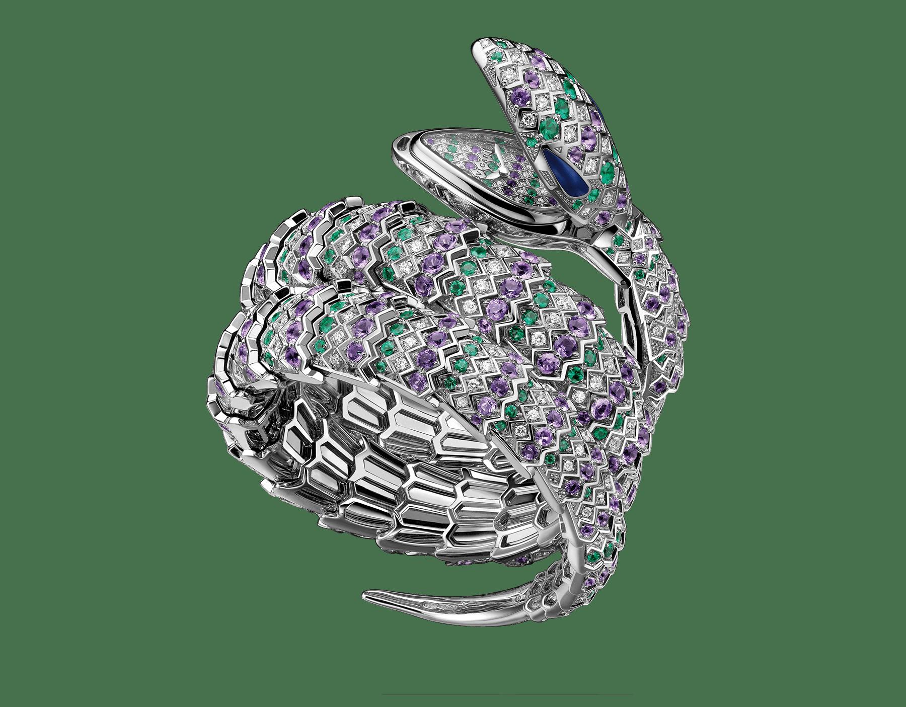 Relógio Secreto Serpenti com cabeça em ouro branco 18K cravejado com diamantes lapidação brilhante, ametistas, esmeraldas e olhos de malaquita, caixa em ouro branco 18K, mostrador e pulseira de duas voltas em ouro branco 18K cravejados com diamantes lapidação brilhante, ametistas e esmeraldas. 101864 image 1