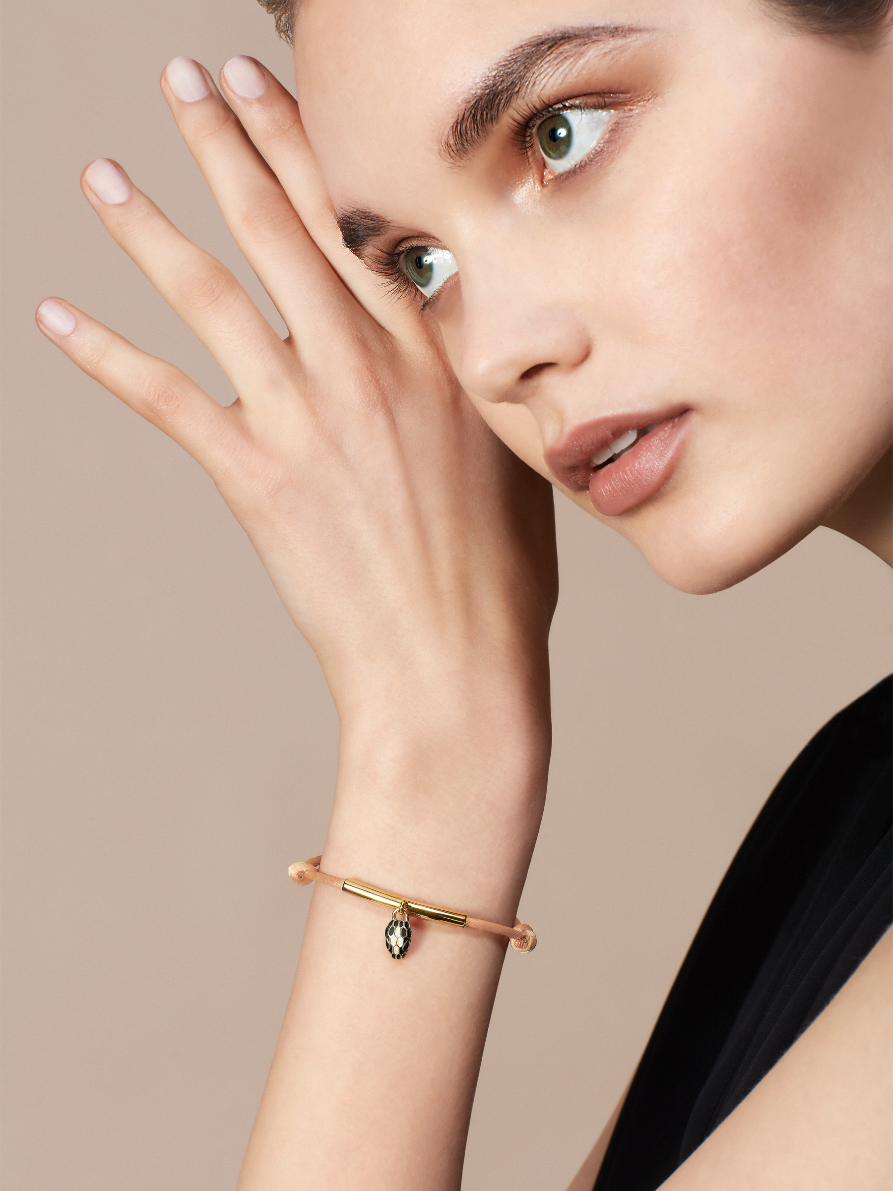 """""""Serpenti Forever"""" bracelet in Mimetic Jade green fabric, with a gold-plated brass plate. Iconic snakehead charm enameled in black and white agate, with seductive black enamel eyes. SERP-MINISTRINGa image 2"""