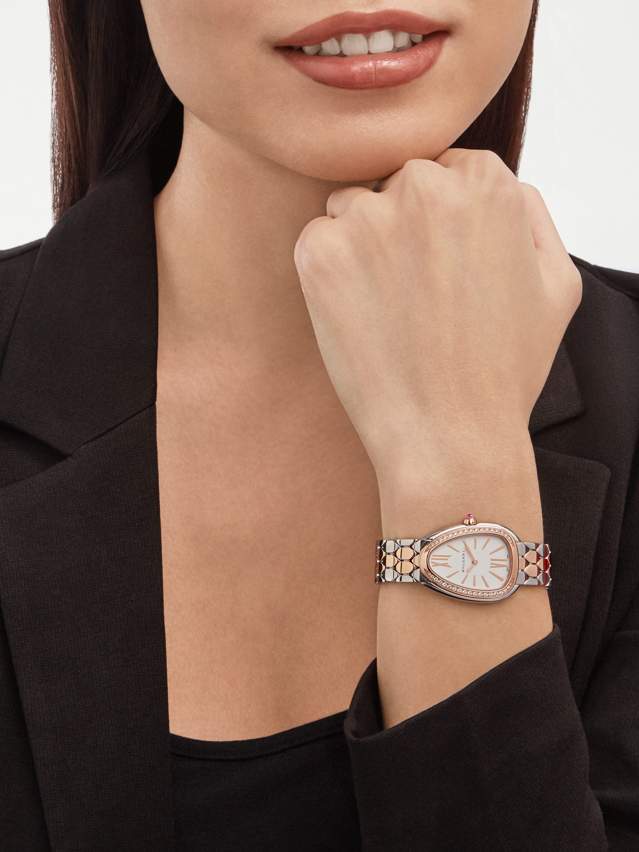 Serpenti Seduttori watch with stainless steel case, 18 kt rose gold bezel set with diamonds, white dial, and 18 kt rose gold and stainless steel bracelet 103274 image 1