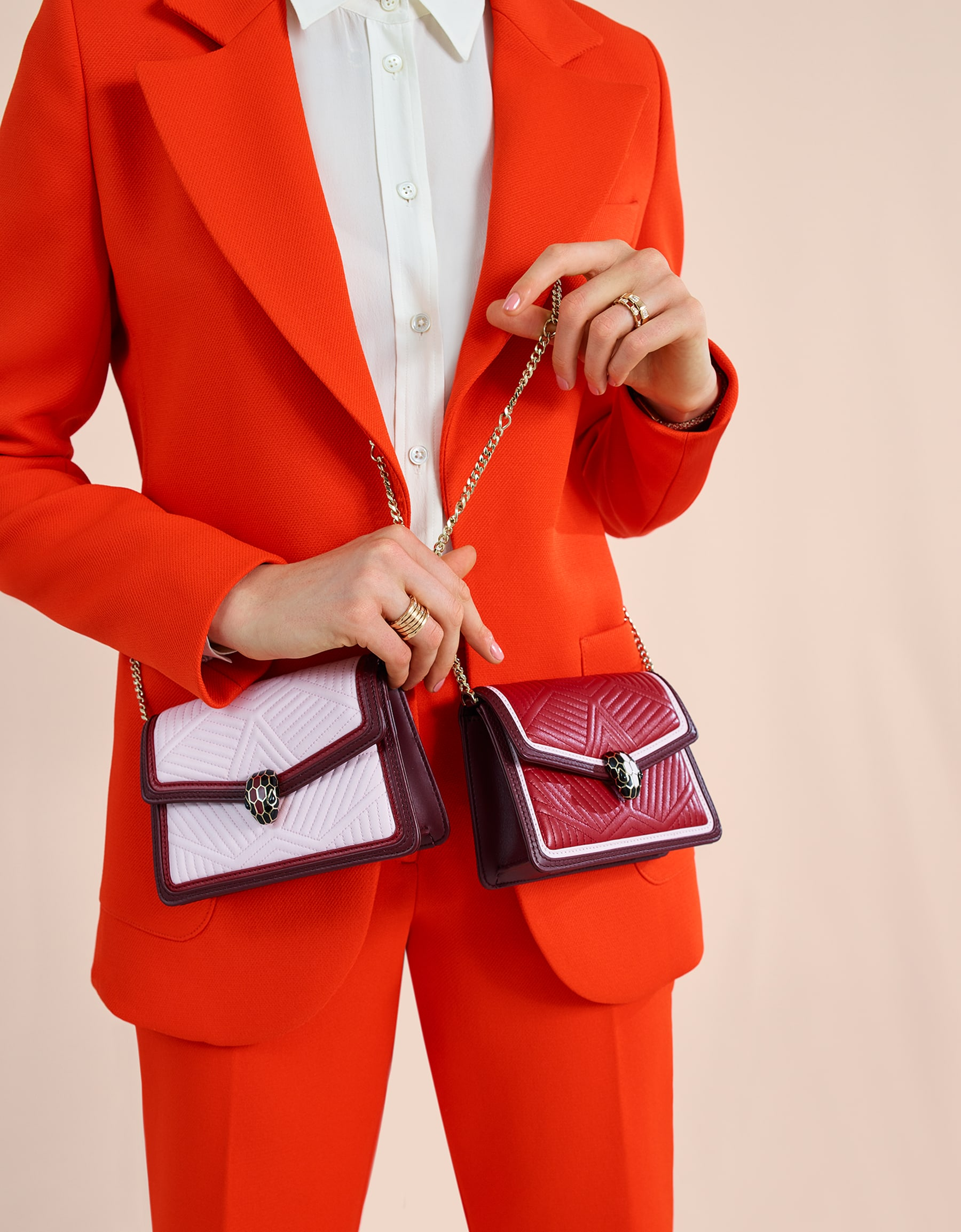 """""""Serpenti Diamond Blast"""" crossbody micro bag in ruby red quilted nappa leather body and Roman garnet calf leather frames. Iconic snakehead closure in light gold plated brass enriched with black and rosa di francia enamel and black onyx eyes. 288845 image 5"""