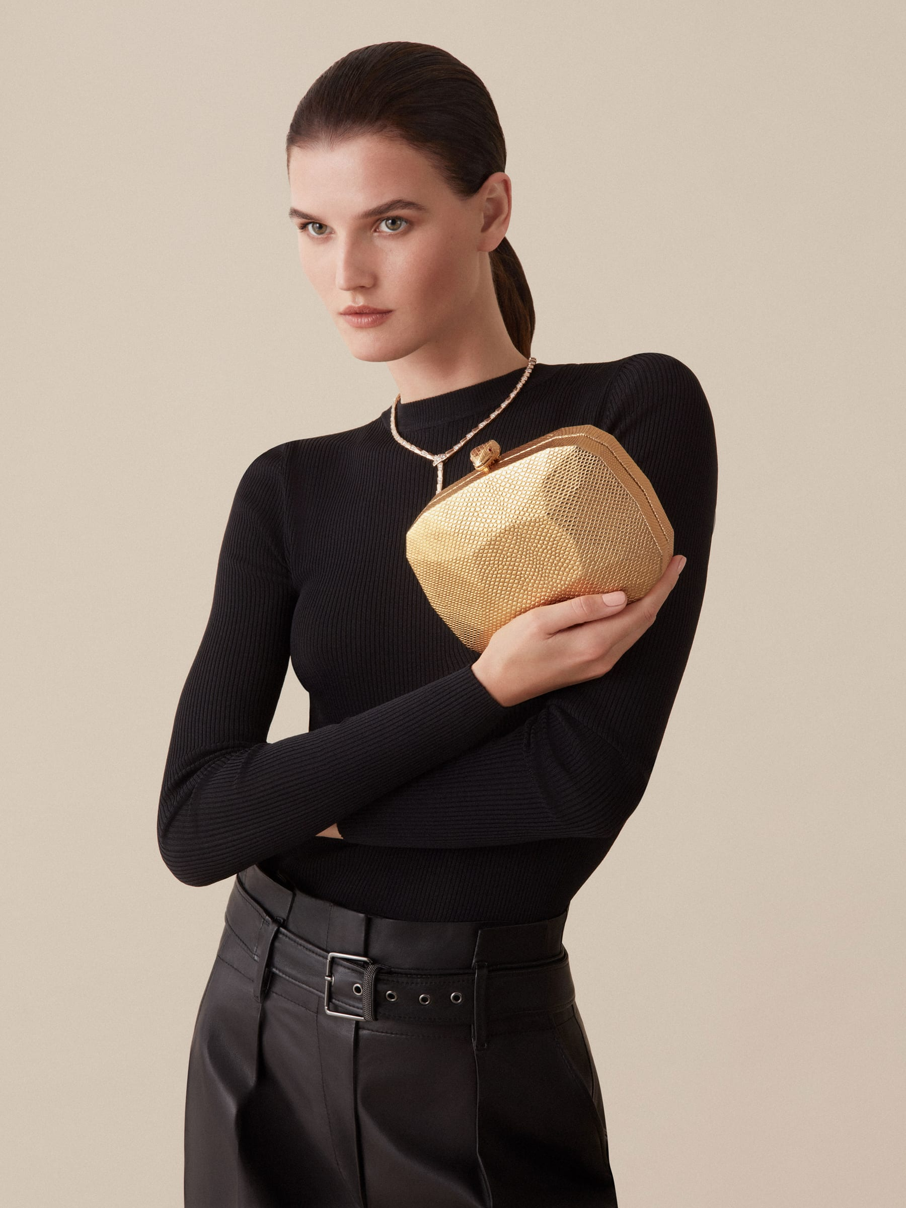 """""""BVLGARI Cocktail"""" hard clutch in """"Molten"""" gold karung skin with black nappa leather inner lining. New Serpenti head closure in gold-plated brass complete with ruby-red enamel eyes. 526-BRILLIANTCUT image 3"""