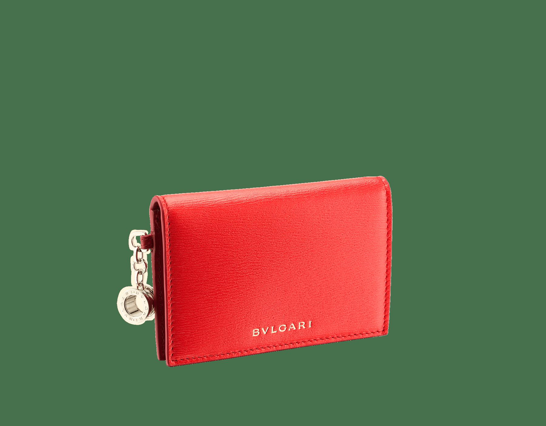 B.zero1 open credit card holder in sea star coral and carmine jasper goatskin. Iconic B.zero1 charm in light gold-plated brass. 288237 image 1
