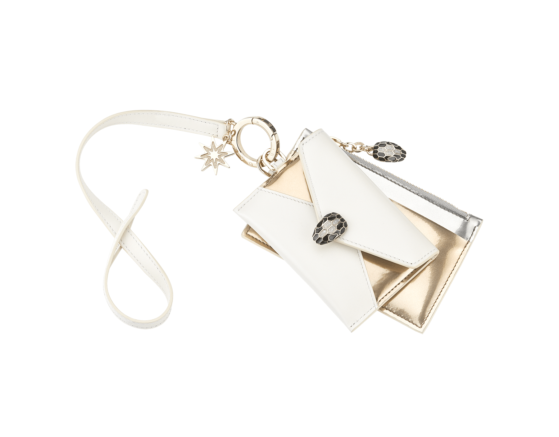 Serpenti Forever Holiday Season Duo key holder in white agate calf leather, antique bronze and silver brushed metallic calf leather. Brass light gold plated keyring, snakehead closure and zip puller embellished with glitter silver enamel and eight-pointed star charm in glitter light gold enamel. 289542 image 1