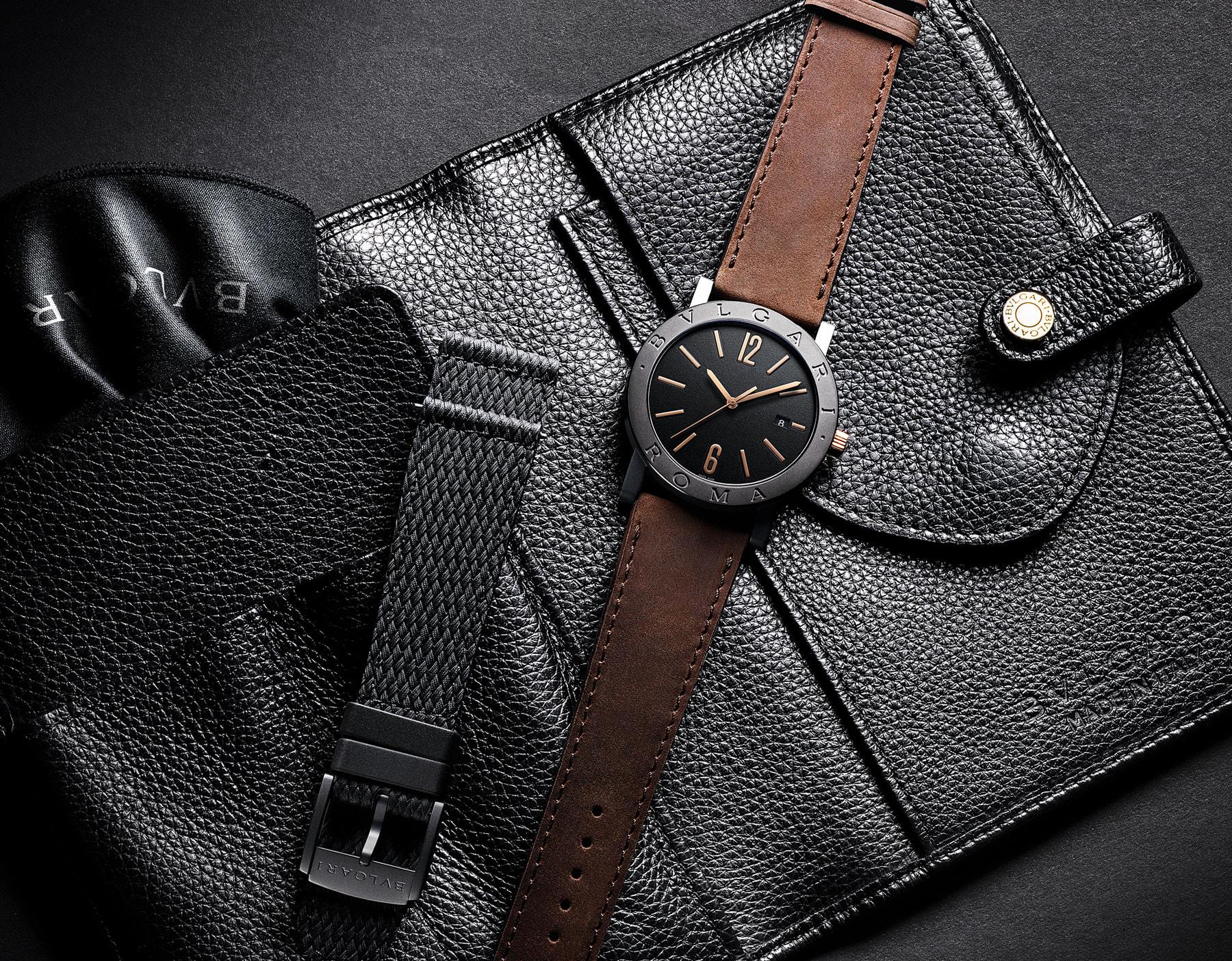 """ساعة """"بولغري بولغري سيتيز سبيشل إيديشن، ROMA"""" بآلية حركة ميكانيكية مصنّعة من قبل بولغري، تعبئة أوتوماتيكية، آلية BVL 191.، علبة الساعة من الفولاذ المعالج بالكربون الأسود الشبيه بالألماس مع نقش """"BVLGARI ROMA"""" على إطار الساعة، غطاء خلفي شفاف، ميناء مطلي بالمينا الأسود الخشن ومؤشرات الساعة من الذهب الوردي، سوار من جلد العجل البني، وسوار قابل للتبديل من المطاط الأسود. 103219 image 7"""