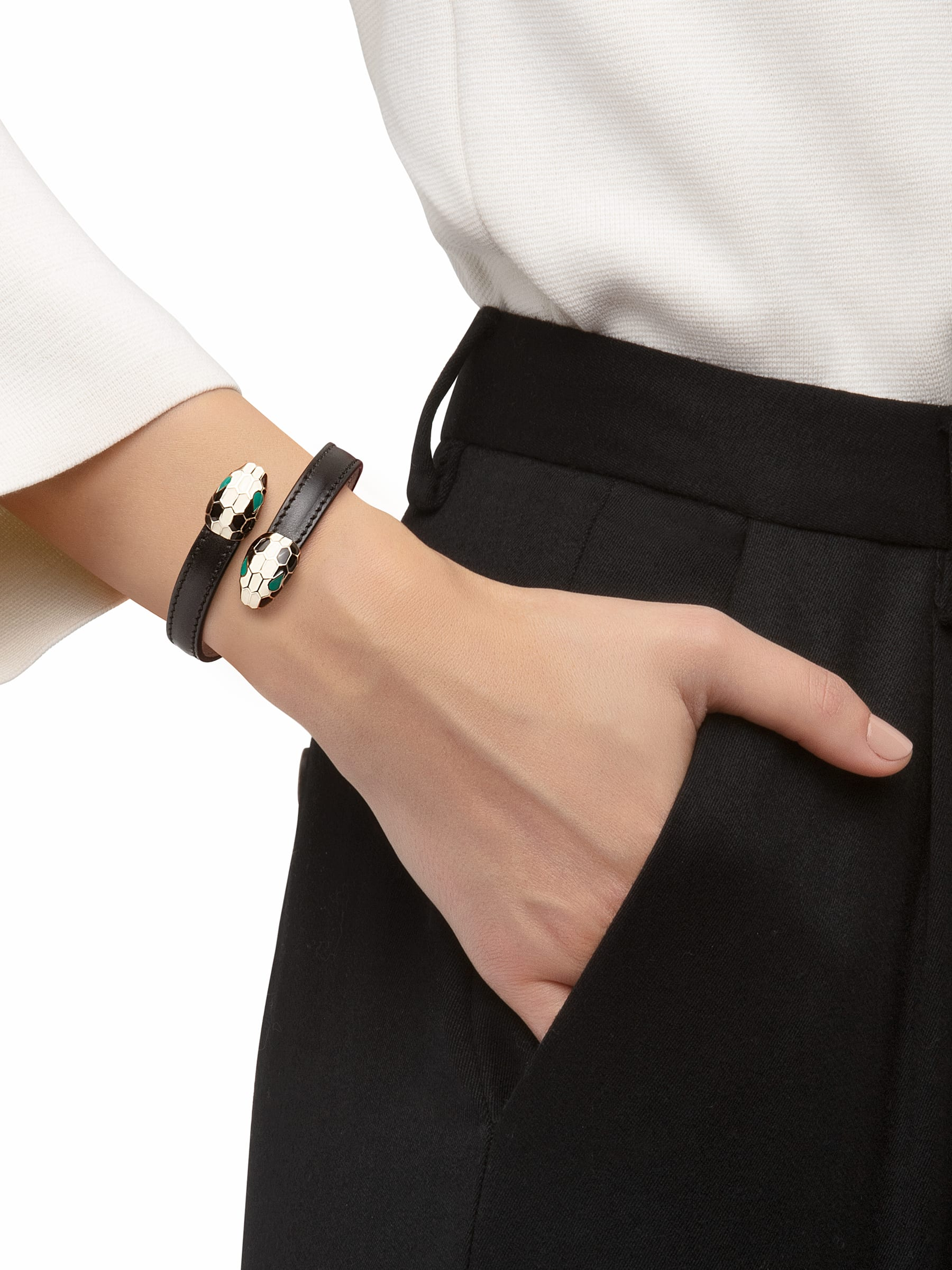 Serpenti Forever soft bangle bracelet in black calf leather, with brass light gold plated hardware. Iconic contraire snakehead décor in black and white enamel, with green enamel eyes. 287398 image 2