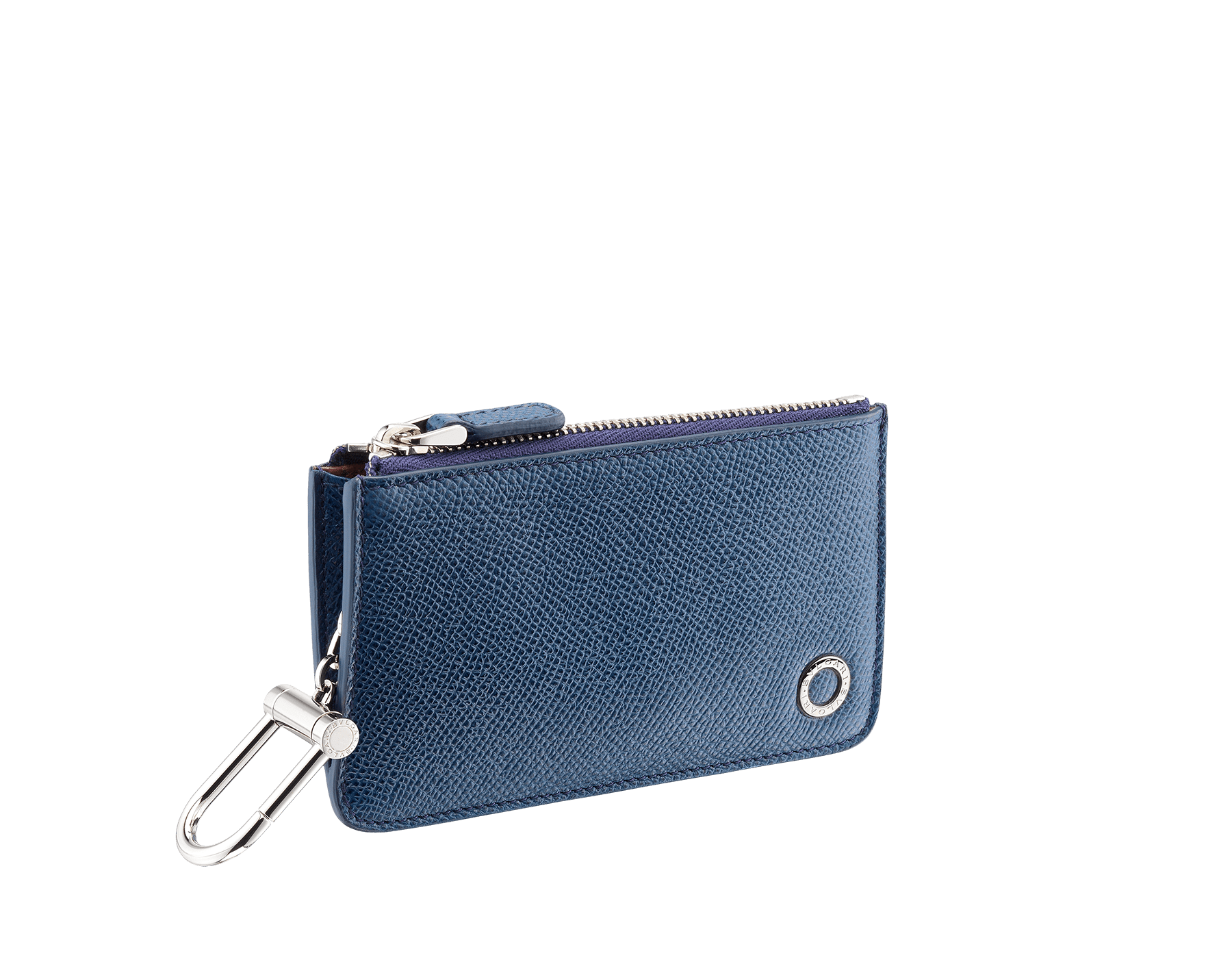 Zipped coin holder in denim sapphire grain calf leather and bordeaux nappa lining, with snap hook keyring and metal parts in brass palladium plating. Iconic BVLGARI BVLGARI motif. 282605 image 1