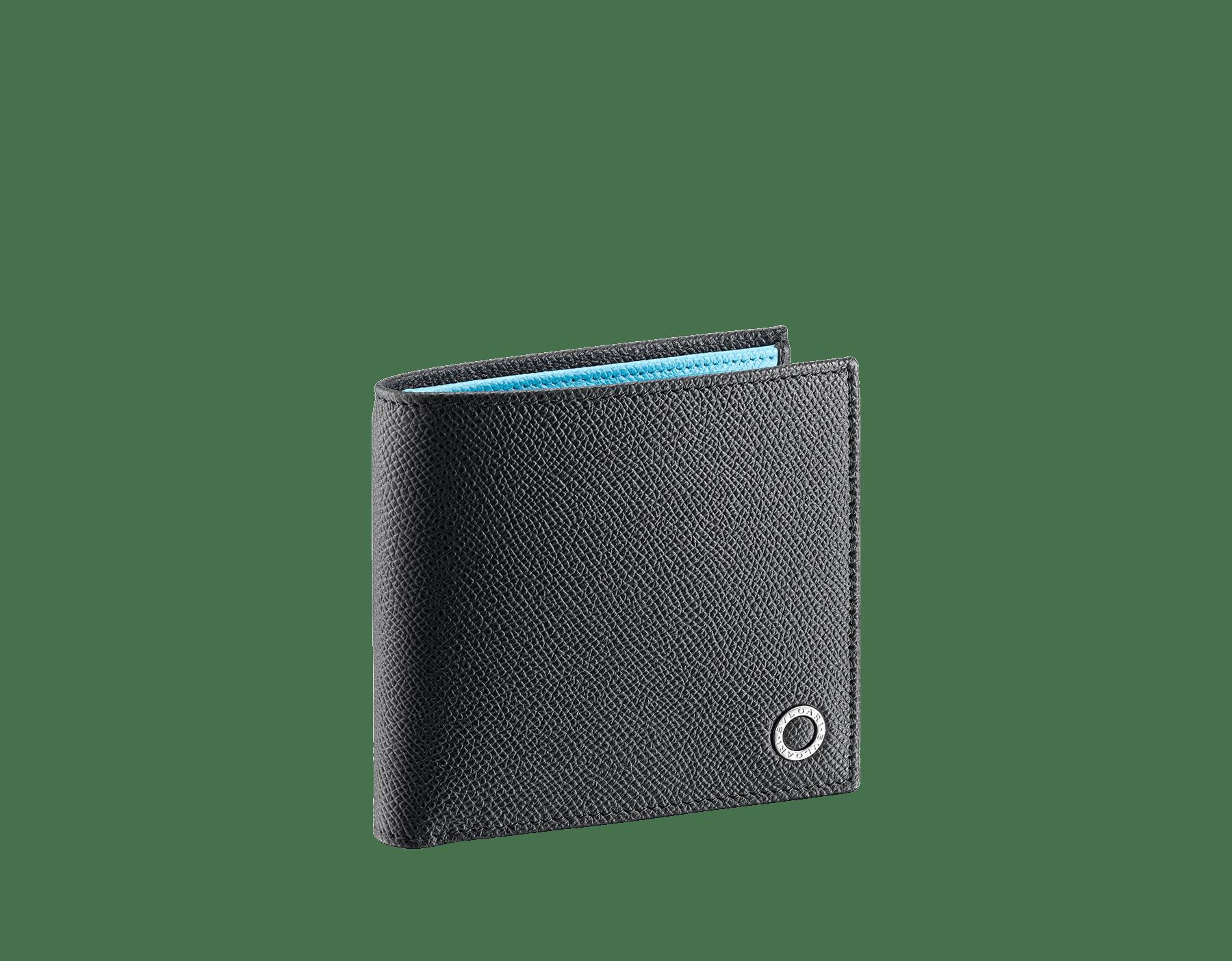 """BVLGARI BVLGARI"" compact wallet in Charcoal Diamond grey and light Aegean Topaz blue grained calfskin. Iconic logo-bearing embellishment in palladium-plated brass. 290587 image 1"