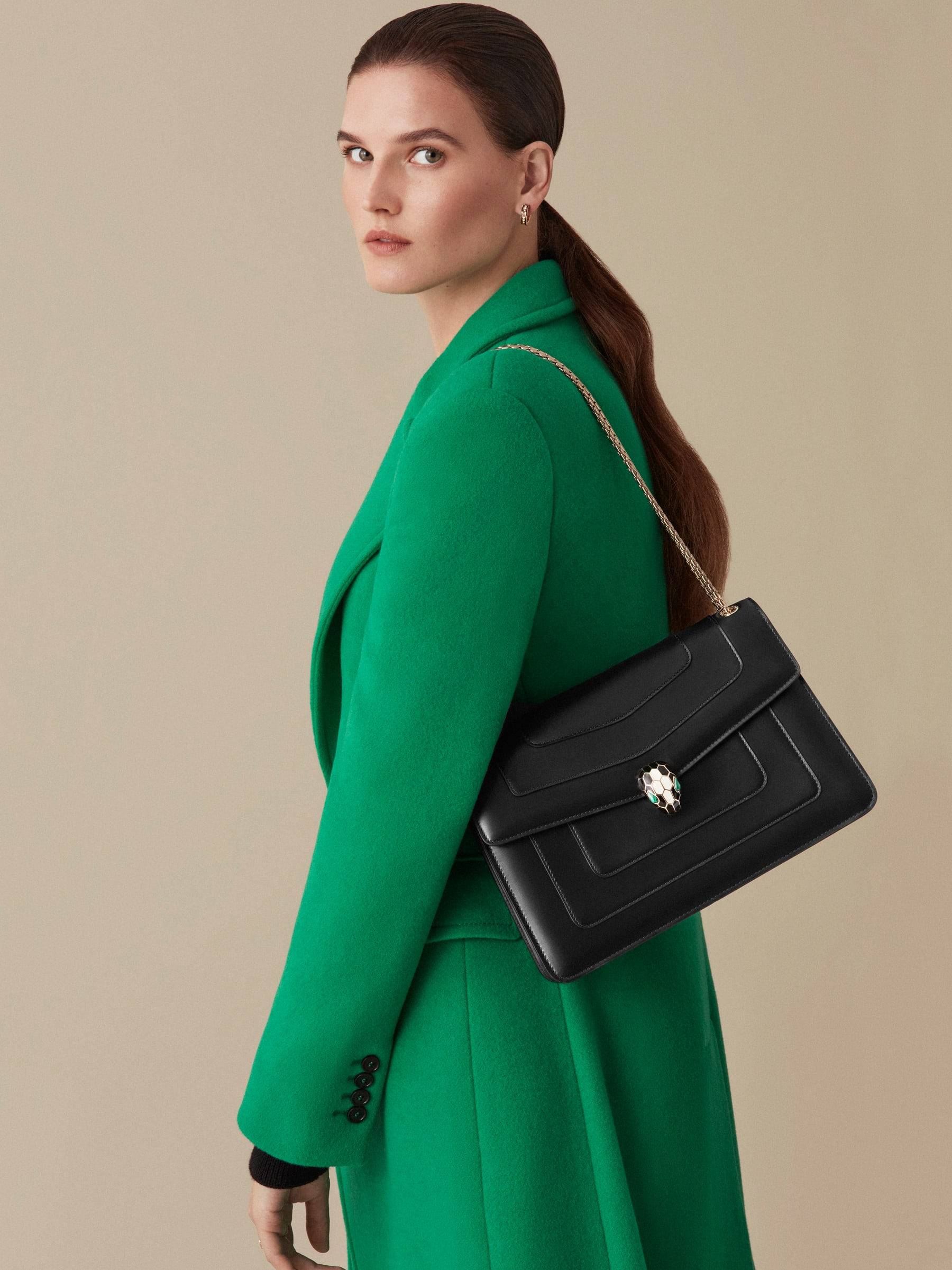 """""""Serpenti Forever"""" shoulder bag in black calf leather with emerald green gros grain internal lining. Iconic snakehead closure in light gold plated brass enriched with black and white agate enamel and green malachite eyes. 1089-Cla image 4"""