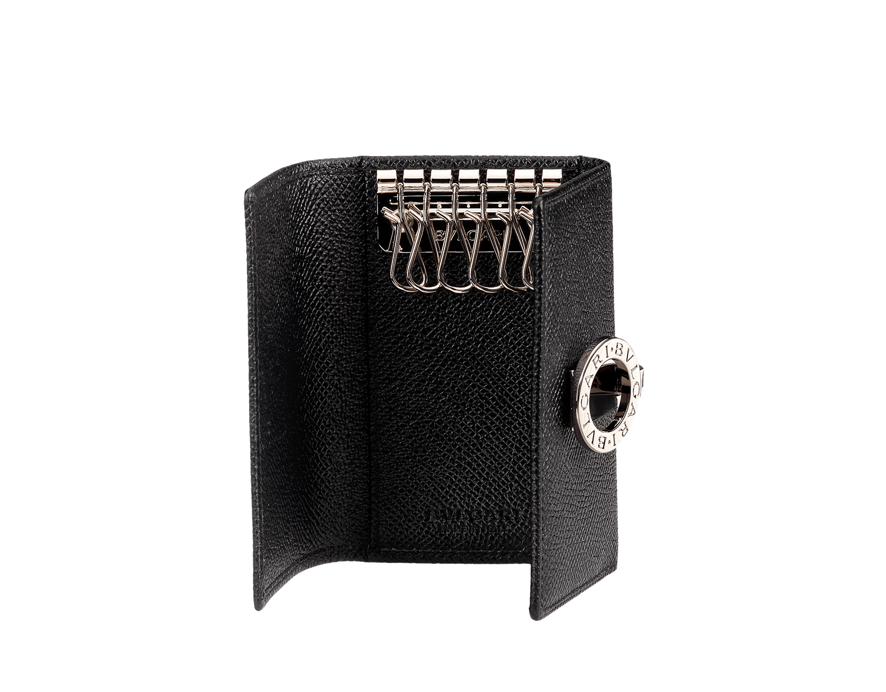 Black grain calf leather keyholder. Flap cover with clip and palladium plated hardware. Six internal keyholders. Dimensions: 2.8 x 3.9 (7 x 10 cm) 30422 image 1