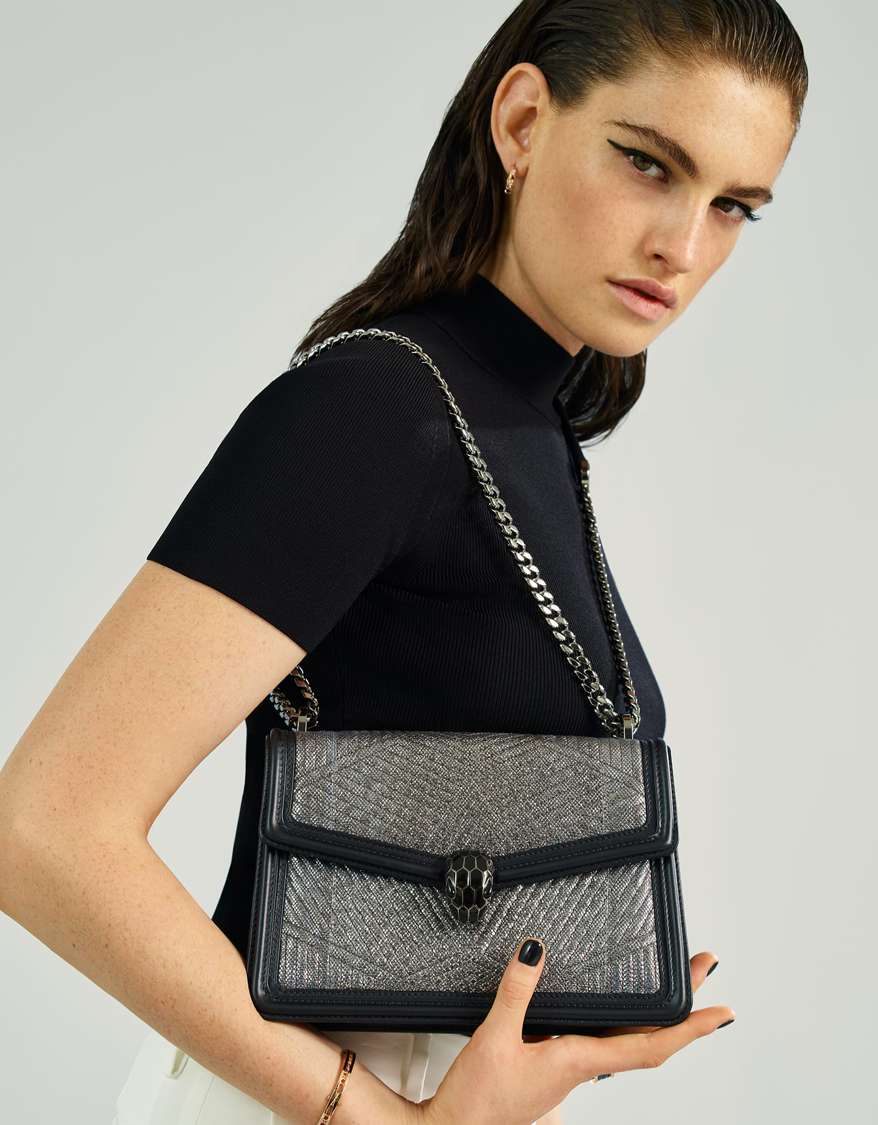 """Serpenti Diamond Blast"" shoulder bag in charcoal diamond quilted metallic karung skin and black calf leather frames. Iconic snake head closure in dark ruthenium plated brass enriched with black enamel and black onyx eyes. 289478 image 5"