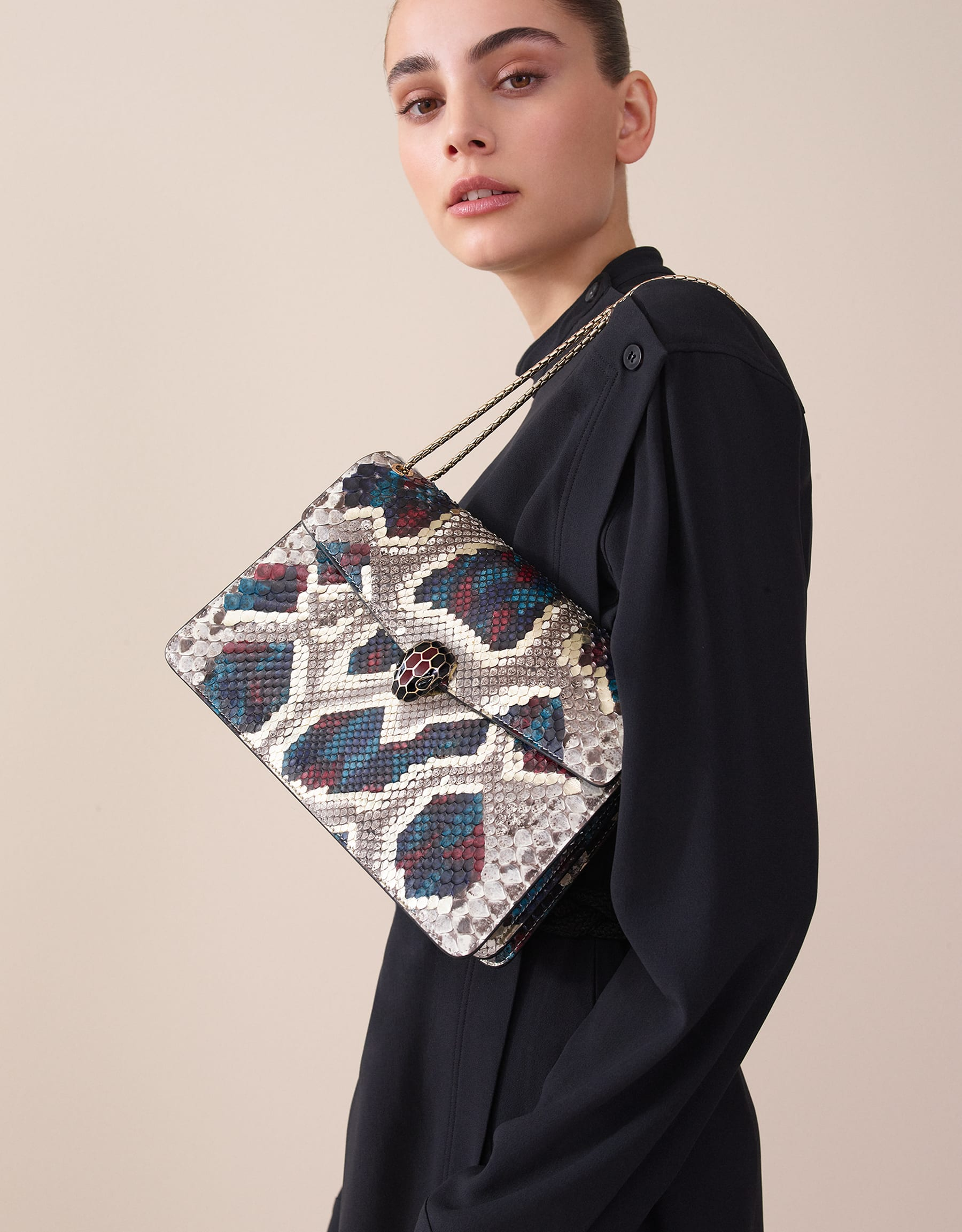 """Serpenti Forever"" shoulder bag in white agate Lunar python skin. Iconic snakehead closure in light gold plated brass enriched with black and roman garnet enamel and black onyx eyes. 521-Pa image 6"