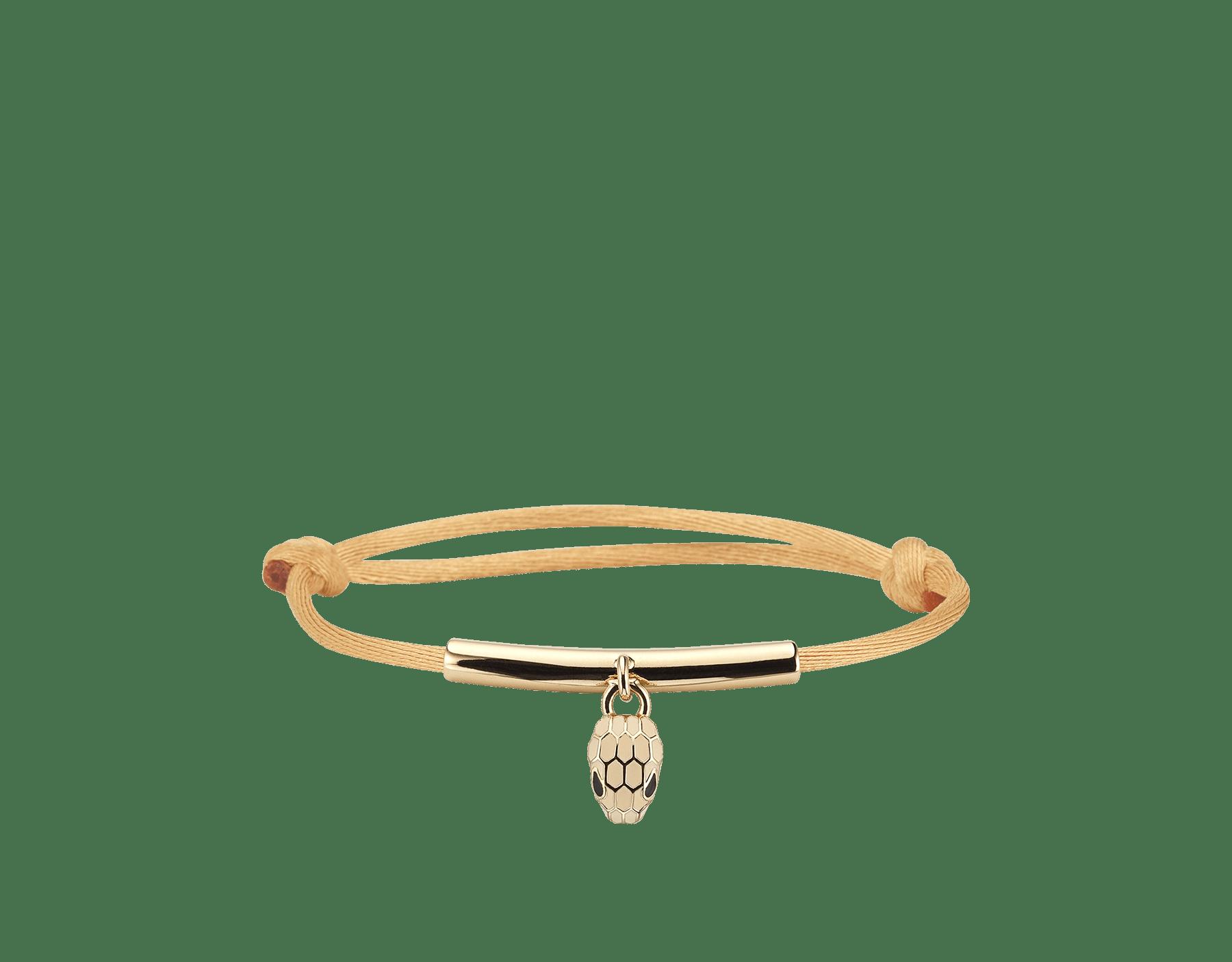 Bracelet Serpenti Forever en tissu couleur vert Mimetic Jade avec une plaque en laiton doré. Bijou Serpenti emblématique émaillé noir et couleur blanc Agate avec yeux en émail noir au charme envoûtant. SERP-MINISTRINGa image 1