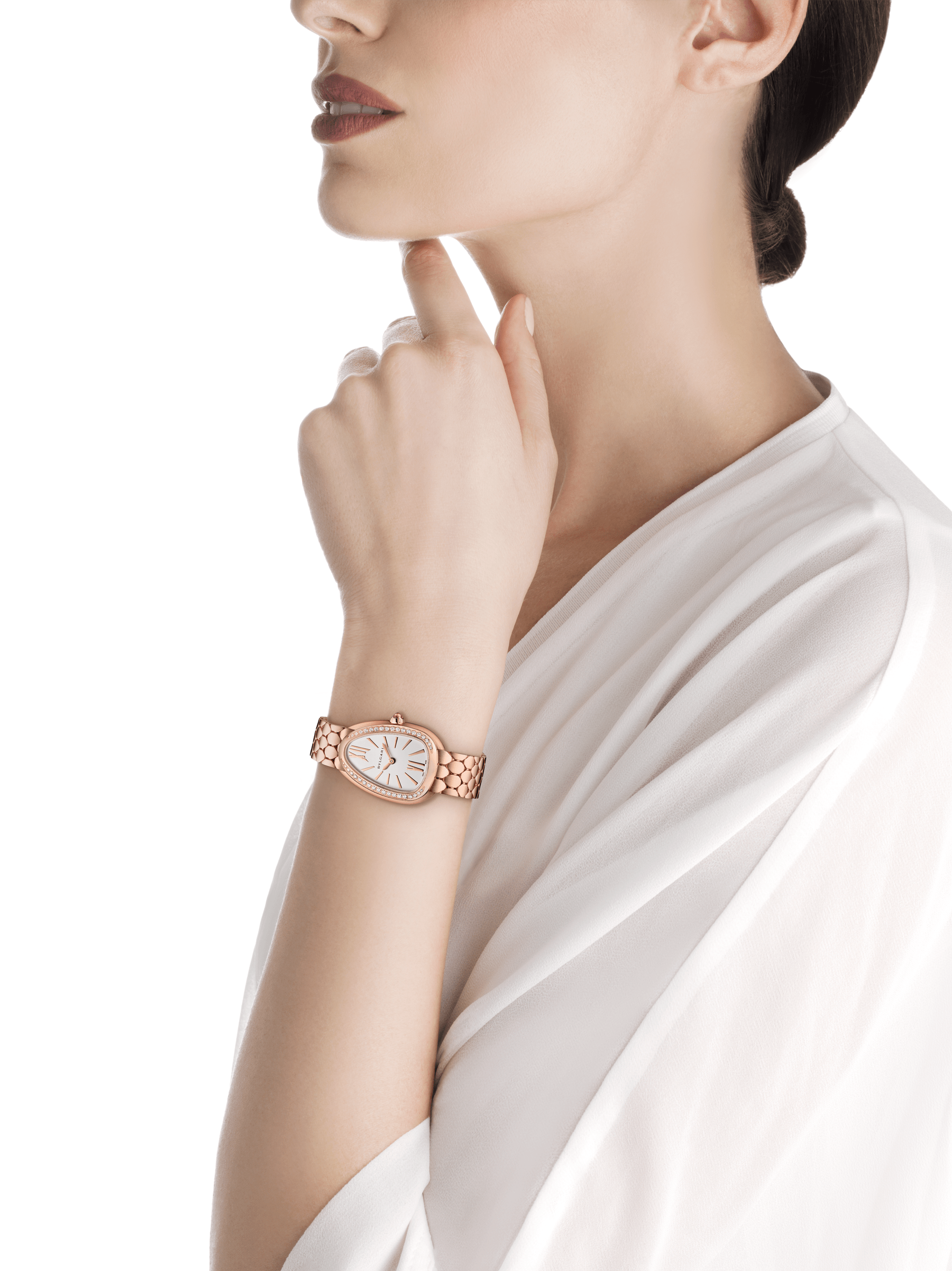 Serpenti Seduttori watch with 18 kt rose gold case, 18 kt rose gold bezel set with diamonds, white silver opaline dial and brushed 18 kt rose gold bracelet. 103169 image 4