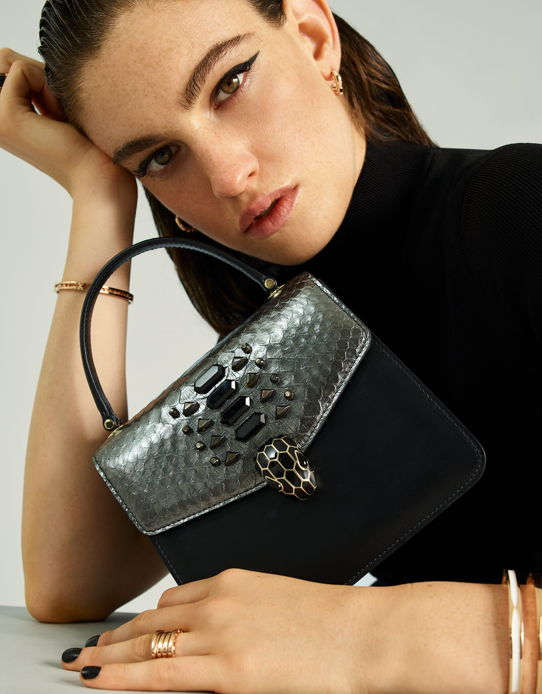 """Serpenti Forever "" crossbody bag in dark silver python skin flap with onyx scales applied and black smooth calf leather body. Iconic snake head closure in light gold plated brass enriched with black enamel and black onyx eyes. 289419 image 5"