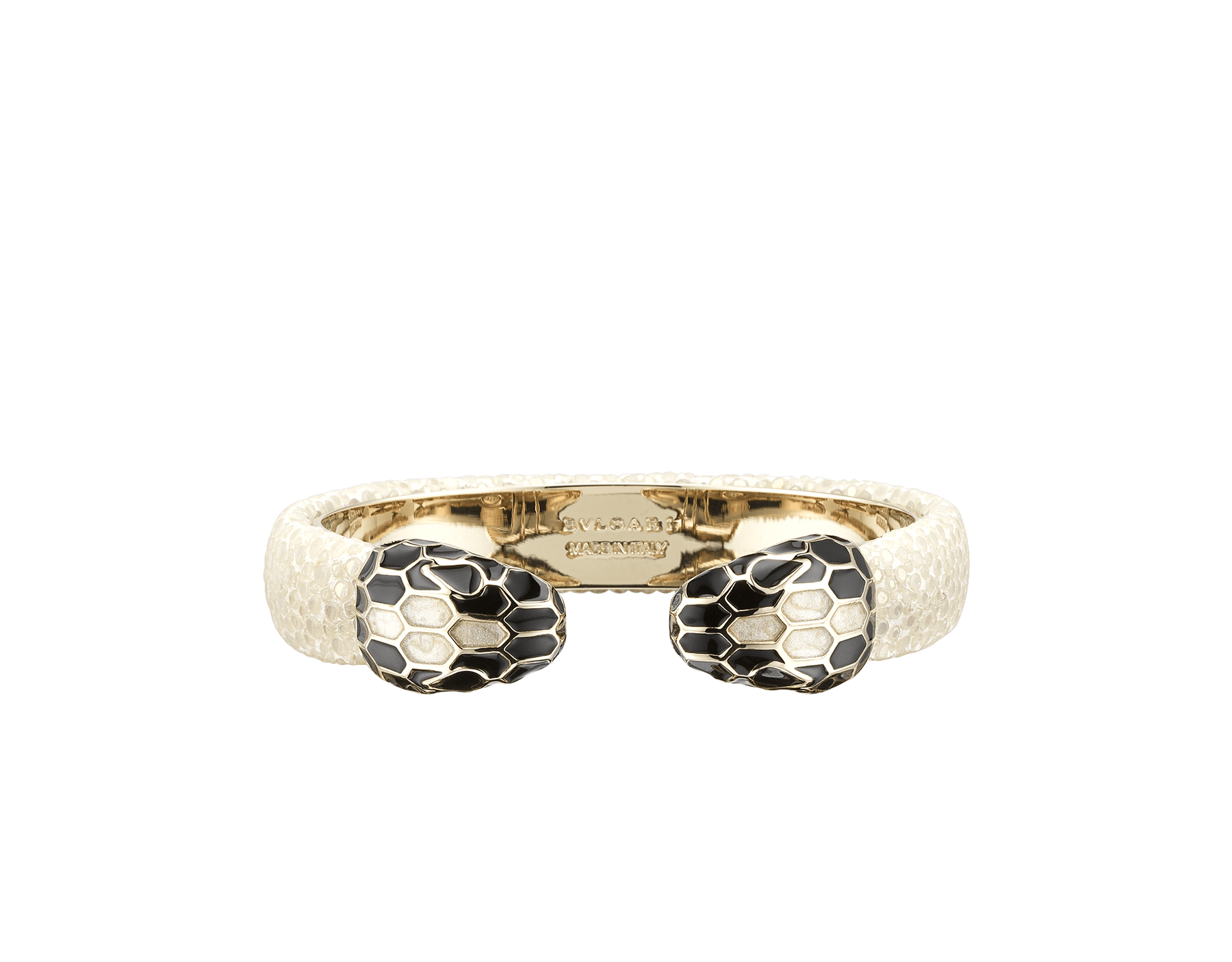 """Serpenti Forever"" bangle bracelet in milky opal galuchat skin with a pearled effect and light gold plated brass hardware. Perfect to accessorise a day-to-night look, this model features an iconic contraire snakehead décor enamelled in black and pearled white agate and finished with seductive black enamel eyes. SPContr-PG-MO image 1"