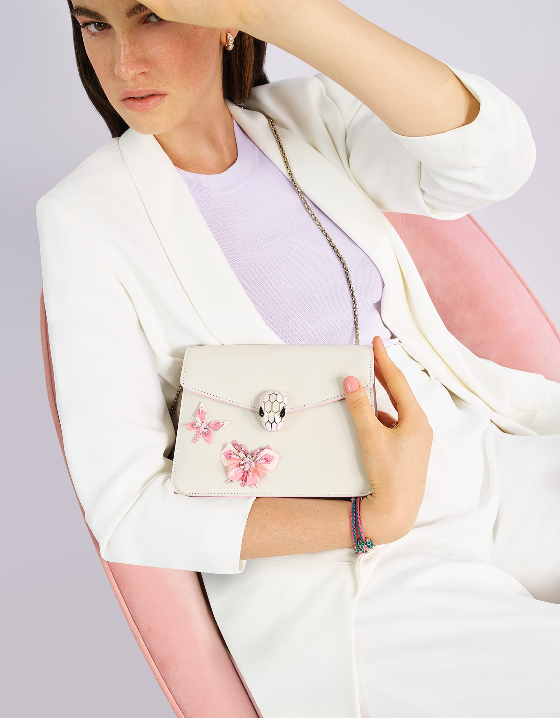 """Serpenti Forever"" crossbody bag in white agate calf leather with two rosa di francia butterflies embroidered. Iconic snakehead closure in light gold plated brass enriched with rosa di francia and white agate enamel and black onyx eyes. 289243 image 2"