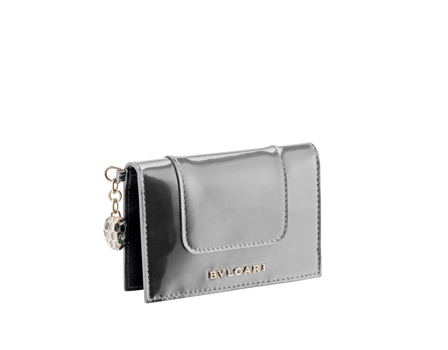 Folded credit card holder in frosted silver brushed metallic calf leather and black calf leather, with brass light gold plated hardware and stud closure. Serpenti head charm in black and white enamel with malachite enamel eyes. Six credit card slots and two compartments. Also available in other colours. 8 x 11,5 cm. - 3.1 x 4.5 282034 image 1