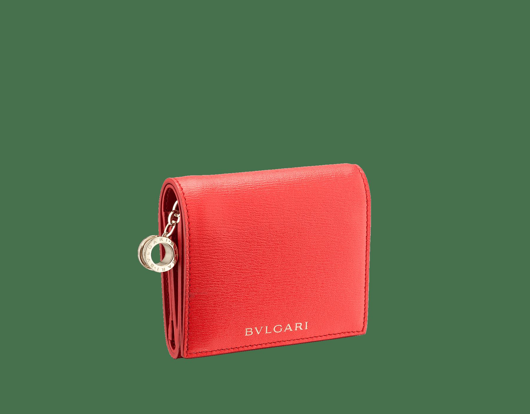 B.zero1 open credit card holder in sea star coral and carmine jasper goatskin. Iconic B.zero1 charm in light gold-plated brass. 288241 image 1