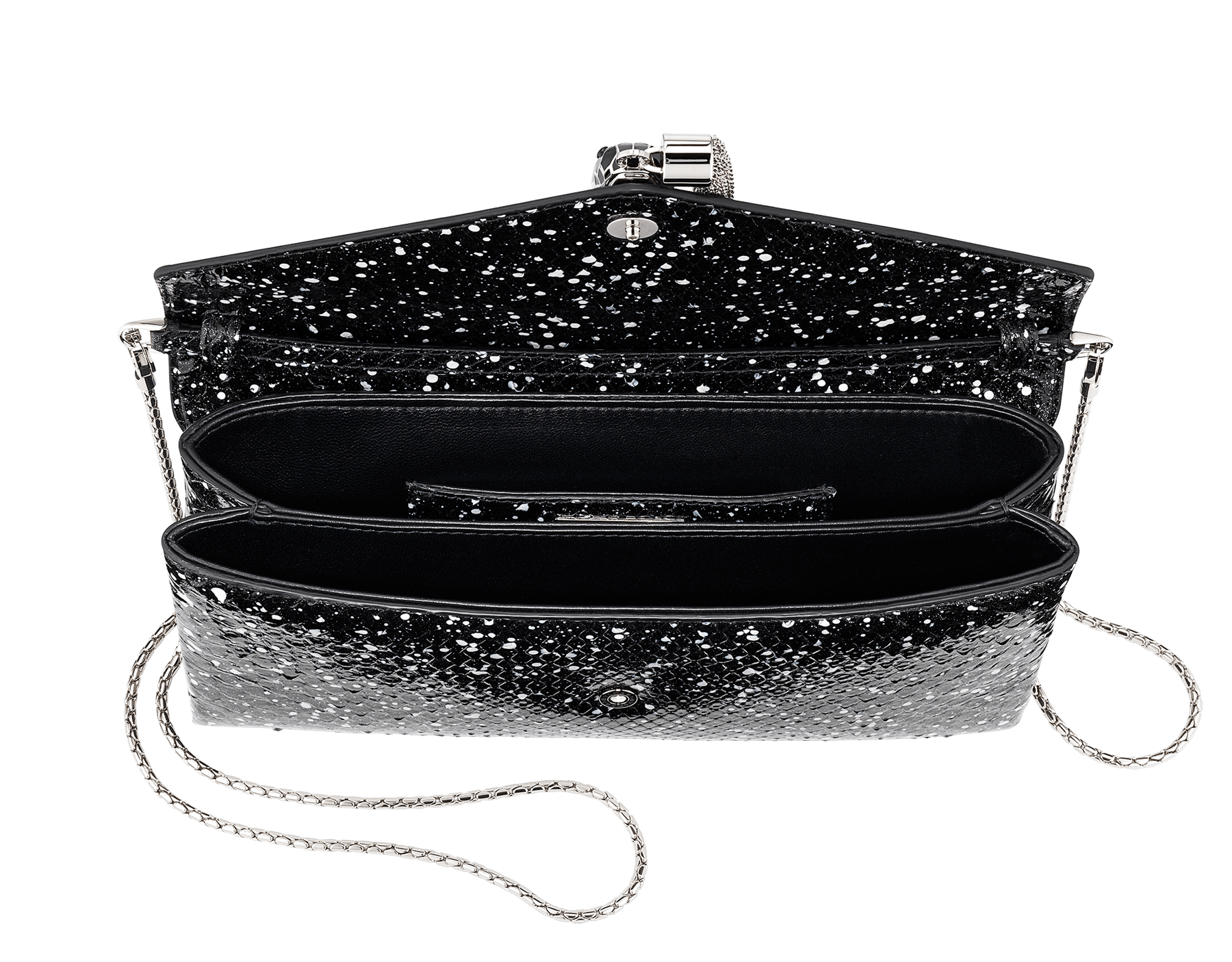 Serpenti evening clutch in black and white Cosmic python skin. Snakehead stud closure with tassel in palladium plated brass decorated with black and white enamel, and black onyx eyes. 288528 image 4