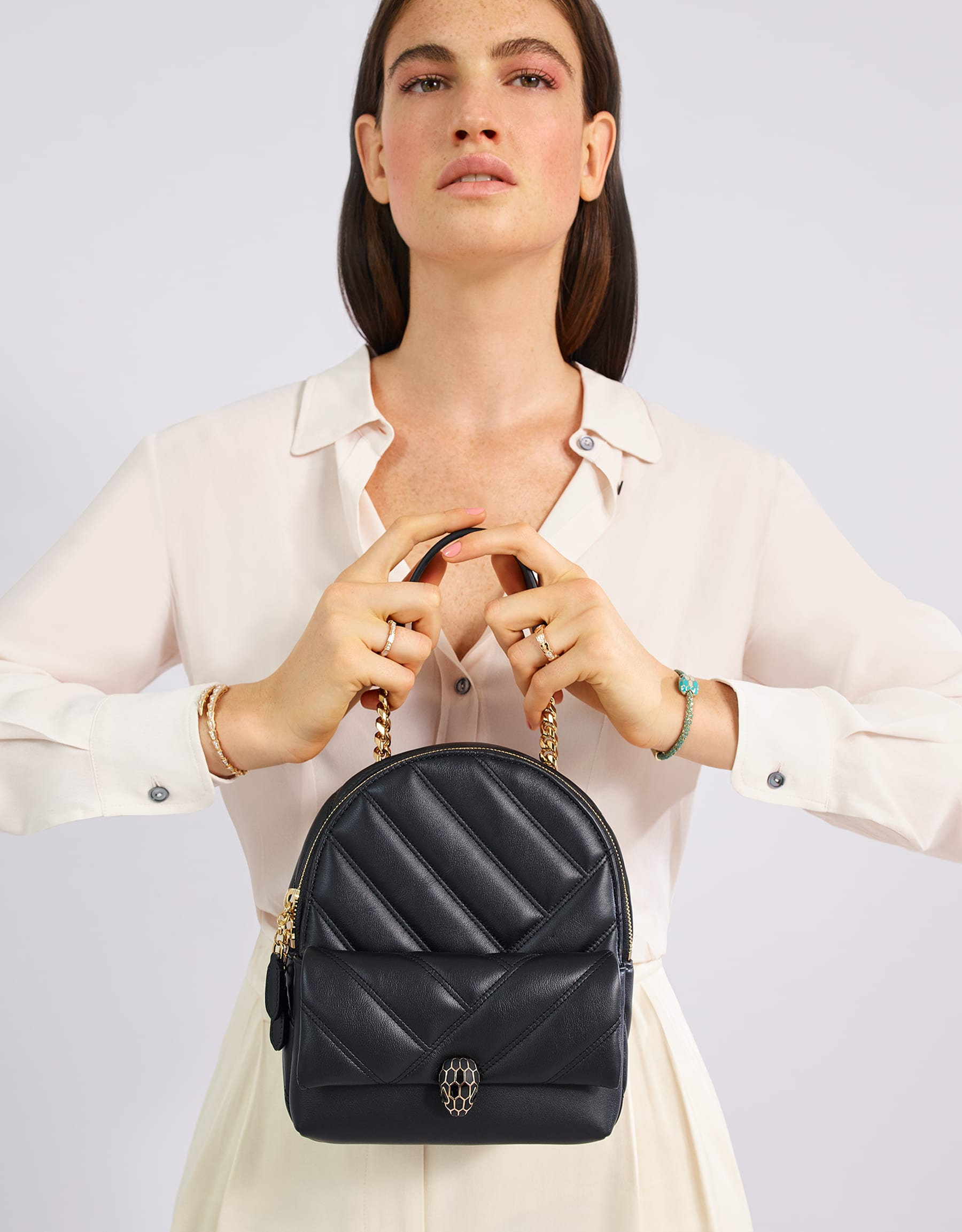Serpenti Cabochon backpack in soft quilted black calf leather, with a graphic motif. Rose gold plated brass tempting snakehead closure in matte and shiny black enamel and black onyx eyes. 288735 image 6