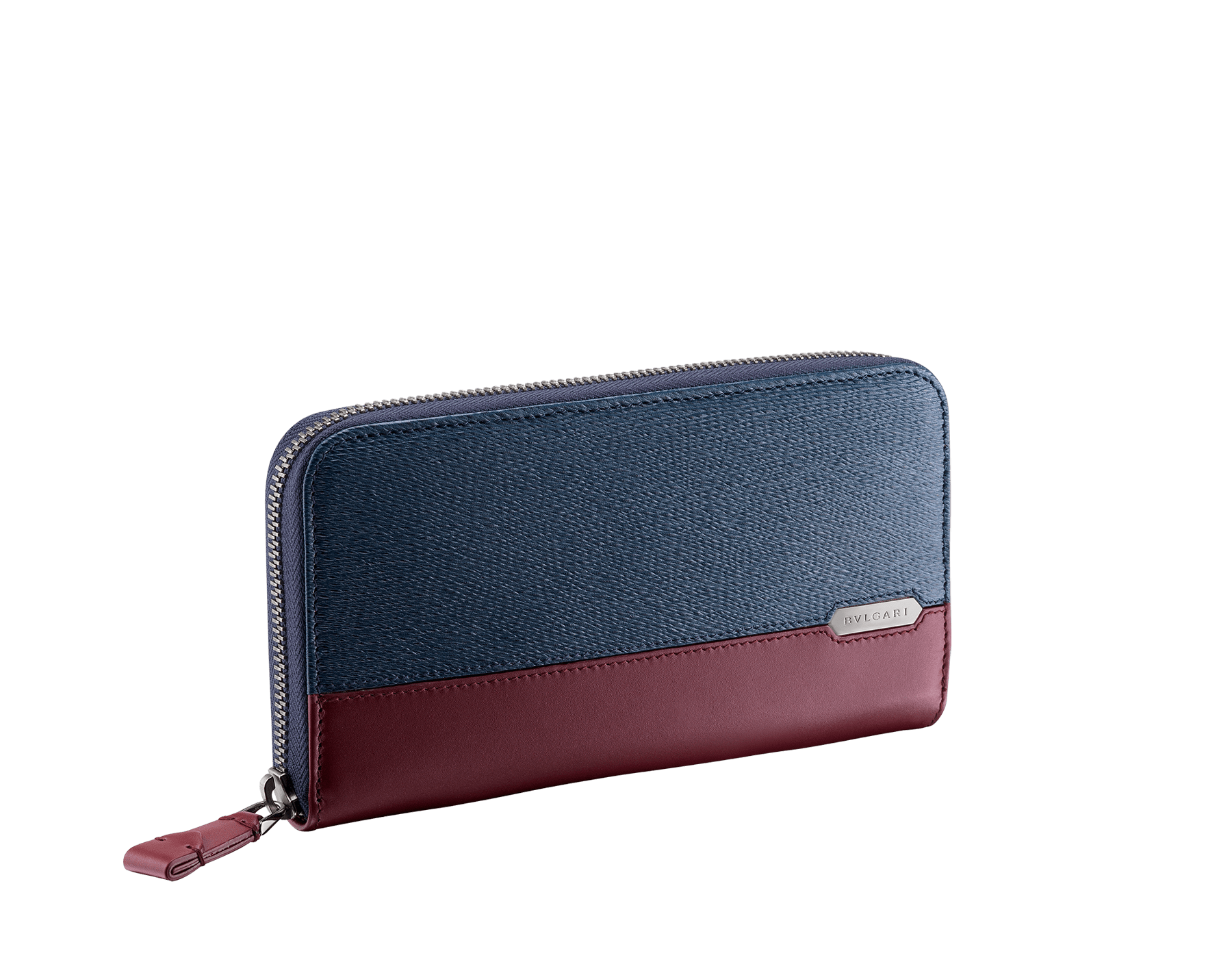 Serpenti Scaglie men's zipped wallet in denim sapphire grazed calf leather and roman garnet calf leather. Bvlgari logo engraved on the hexagonal scaglie metal plate finished in dark ruthenium. 288343 image 1