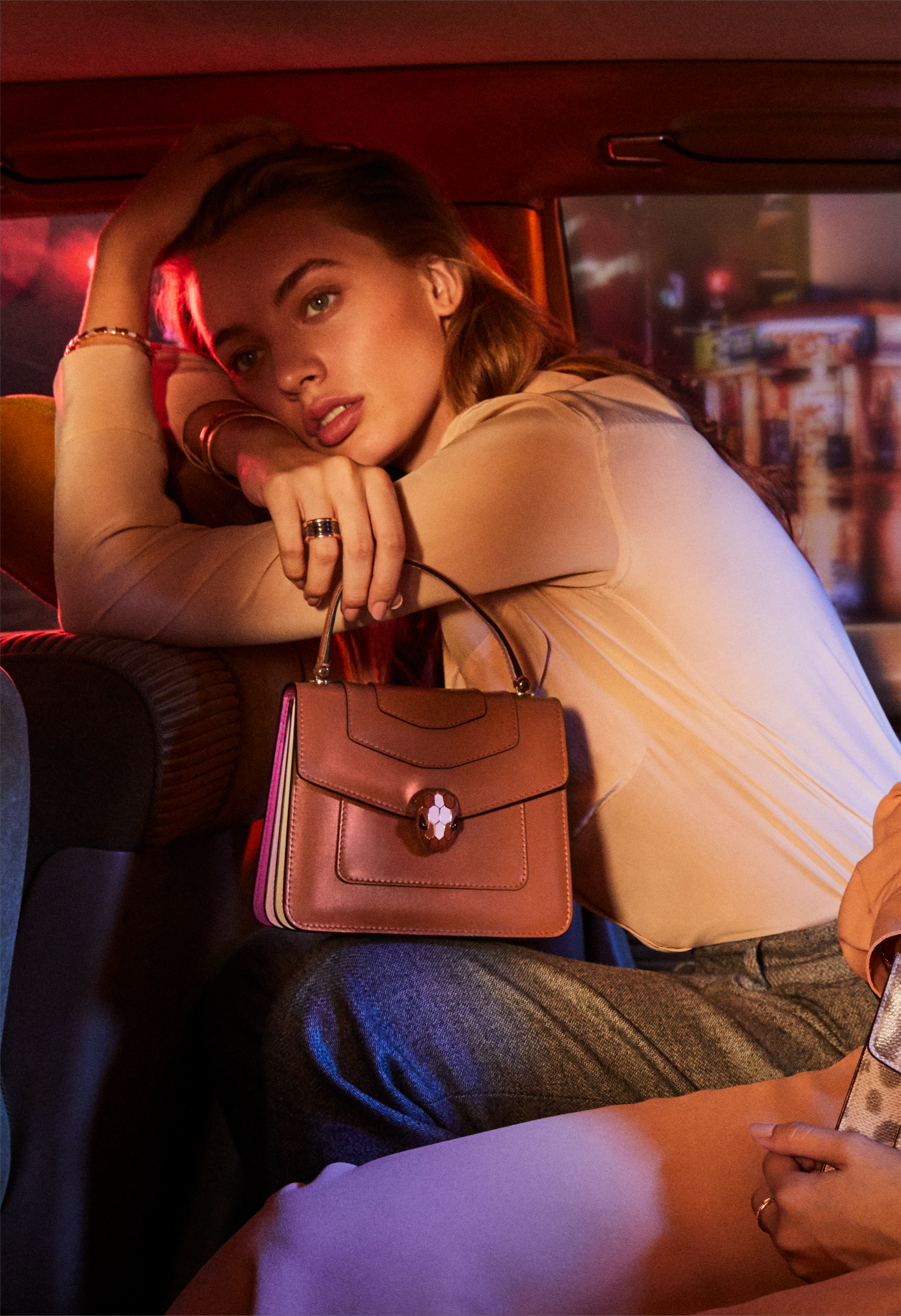 Serpenti Forever crossbody bag in imperial topaz calf leather with Roman garnet, rosa di francia and white agate calf leather sides. Iconic snakehead closure in light gold plated brass embellished with imperial topaz and rosa di francia enamel and black onyx eyes. 288889 image 6