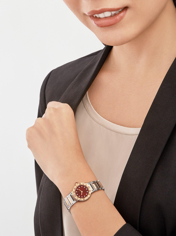 Montre BVLGARI BVLGARI avec boîtier et bracelet en or rose 18K et acier inoxydable, lunette en or rose 18K avec double logo gravé, cadran laqué marron satiné soleil et index sertis de diamants. 103218 image 1