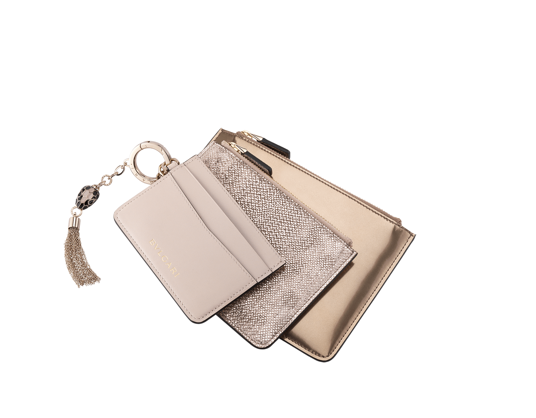 Serpenti Forever Trio in milky opal calf leather, antique bronze brushed metallic calf leather and milky opal metallic karung skin. Brass light gold plated keyring with Serpenti head charm in black and milky opal enamel, with black enamel eyes. SEA-TRIO image 1