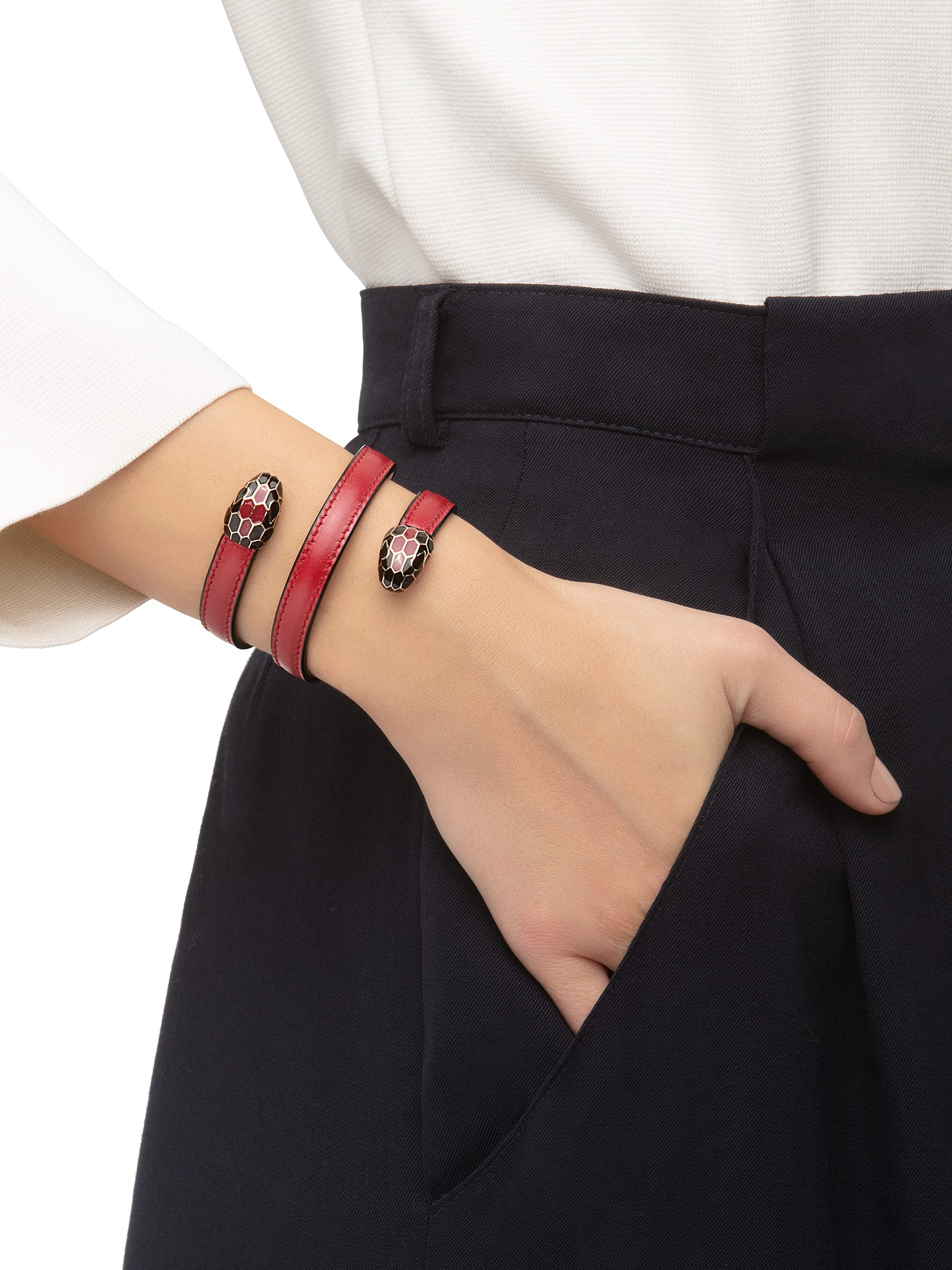Multi-coiled rigid bracelet in ruby red calf leather with brass light gold plated hardware. Double tempting Serpenti head finished in black and tone on tone enamel. 283050 image 2