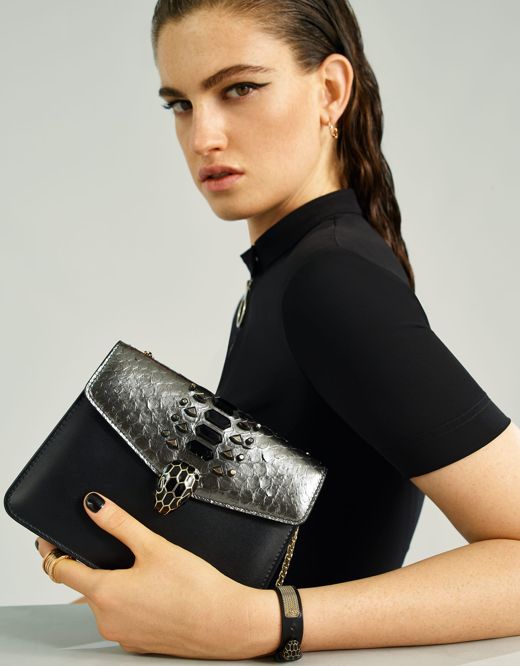 """""""Serpenti Forever"""" crossbody bag in dark silver python skin flap with onyx scales applied and black smooth calf leather body. Iconic snakehead closure in light gold plated brass enriched with matte and shiny black enamel and black onyx eyes. 289420 image 5"""