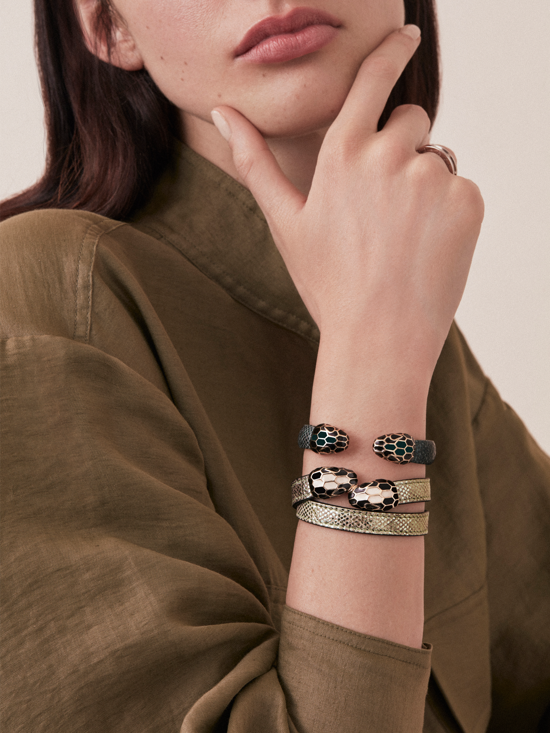 """Serpenti Forever"" multi-coiled bracelet in mint metallic karung, with brass light gold plated hardware. Iconic contraire snakehead décor enameled in black and white and finished with seducing black enamel eyes. MCSerp-MK-M image 2"