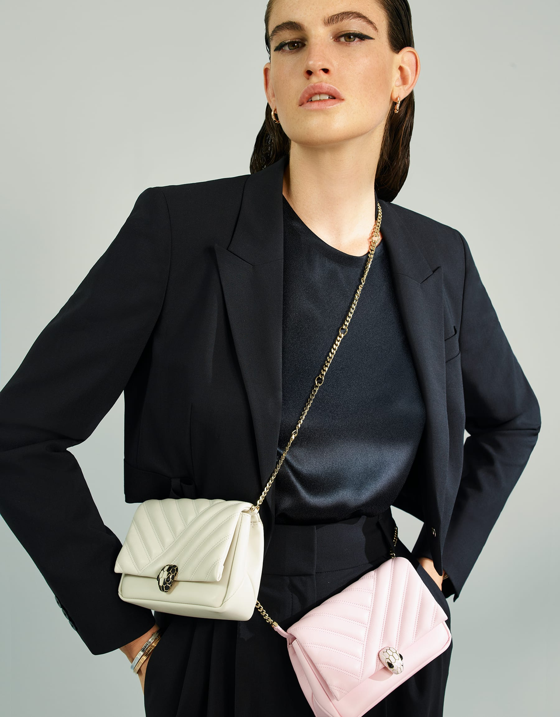 Serpenti Cabochon micro bag in soft matelassé rosa di francia calf leather, with a graphic motif. Brass light gold plated tempting snake head closure in rosa di francia enamel and black onyx eyes. 288758 image 5