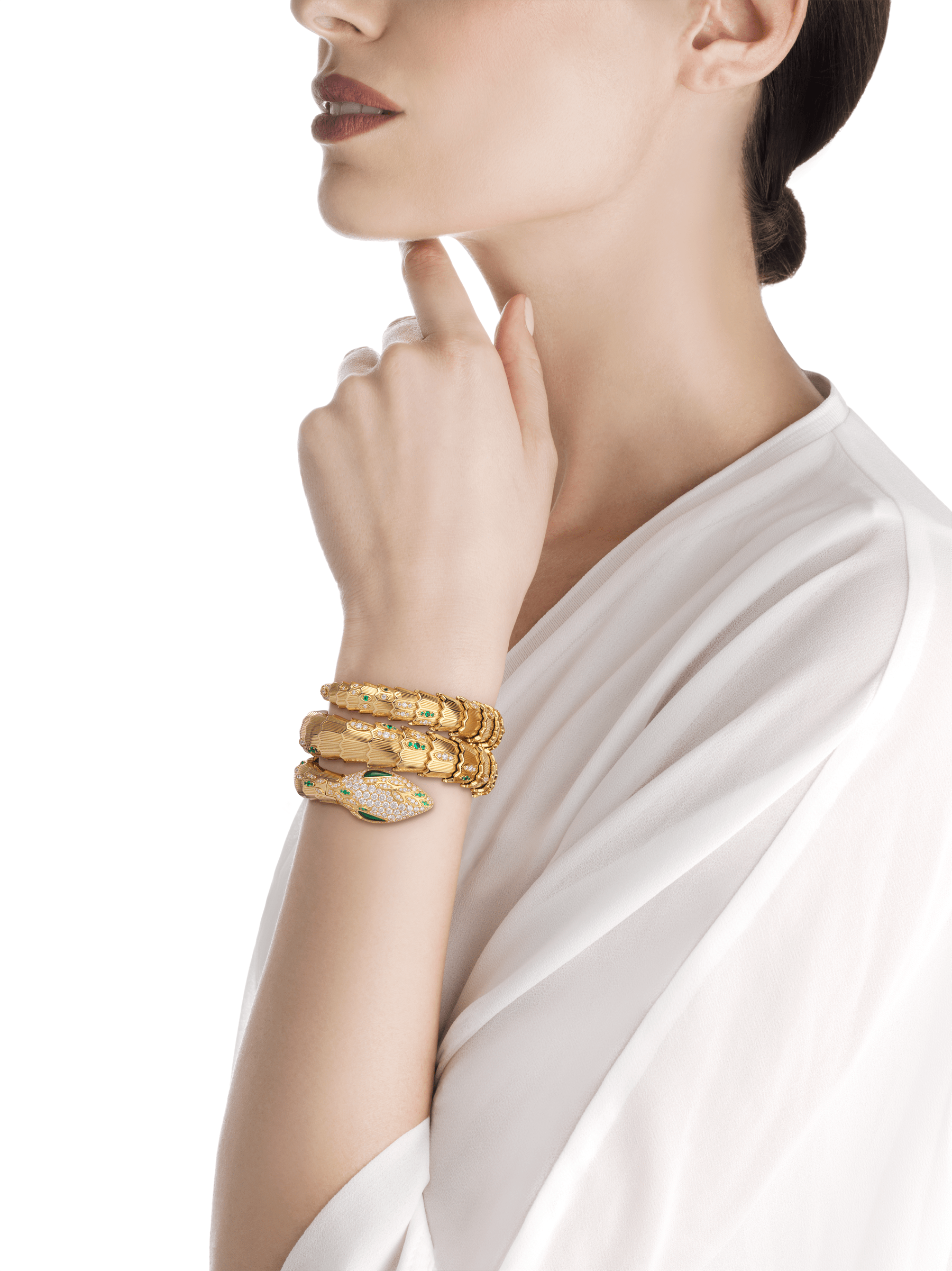 Serpenti Secret Watch with 18 kt yellow gold head set with brilliant cut diamonds, brilliant cut emeralds and malachite eyes, 18 kt yellow gold case, 18 kt yellow gold dial and double spiral bracelet, both set with brilliant cut diamonds and brilliant cut emeralds. 101999 image 2