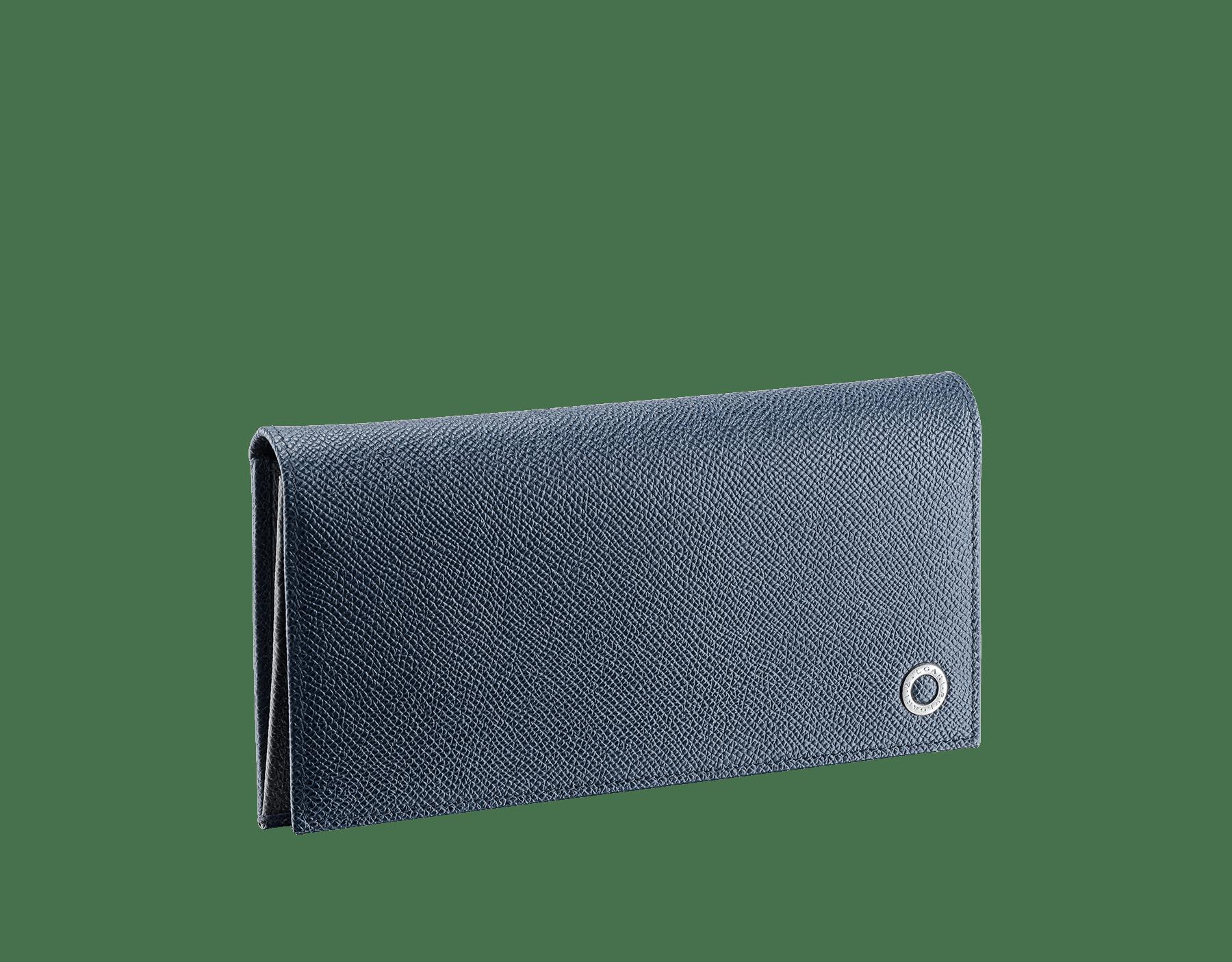Long portefeuille international en cuir de veau grainé couleur Denim Sapphire et Charcoal Diamond avec doublure en cuir nappa bleu ardoise, éléments métalliques en laiton et motif BVLGARIBVLGARI. 289164 image 1